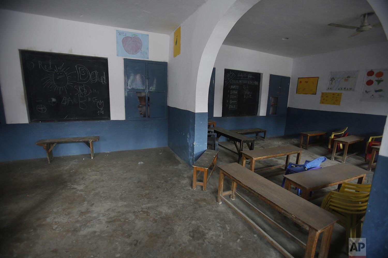 A classroom stands empty at a school in Srinagar, Indian controlled Kashmir, Tuesday, Sept. 17, 2019. (AP Photo/Mukhtar Khan)
