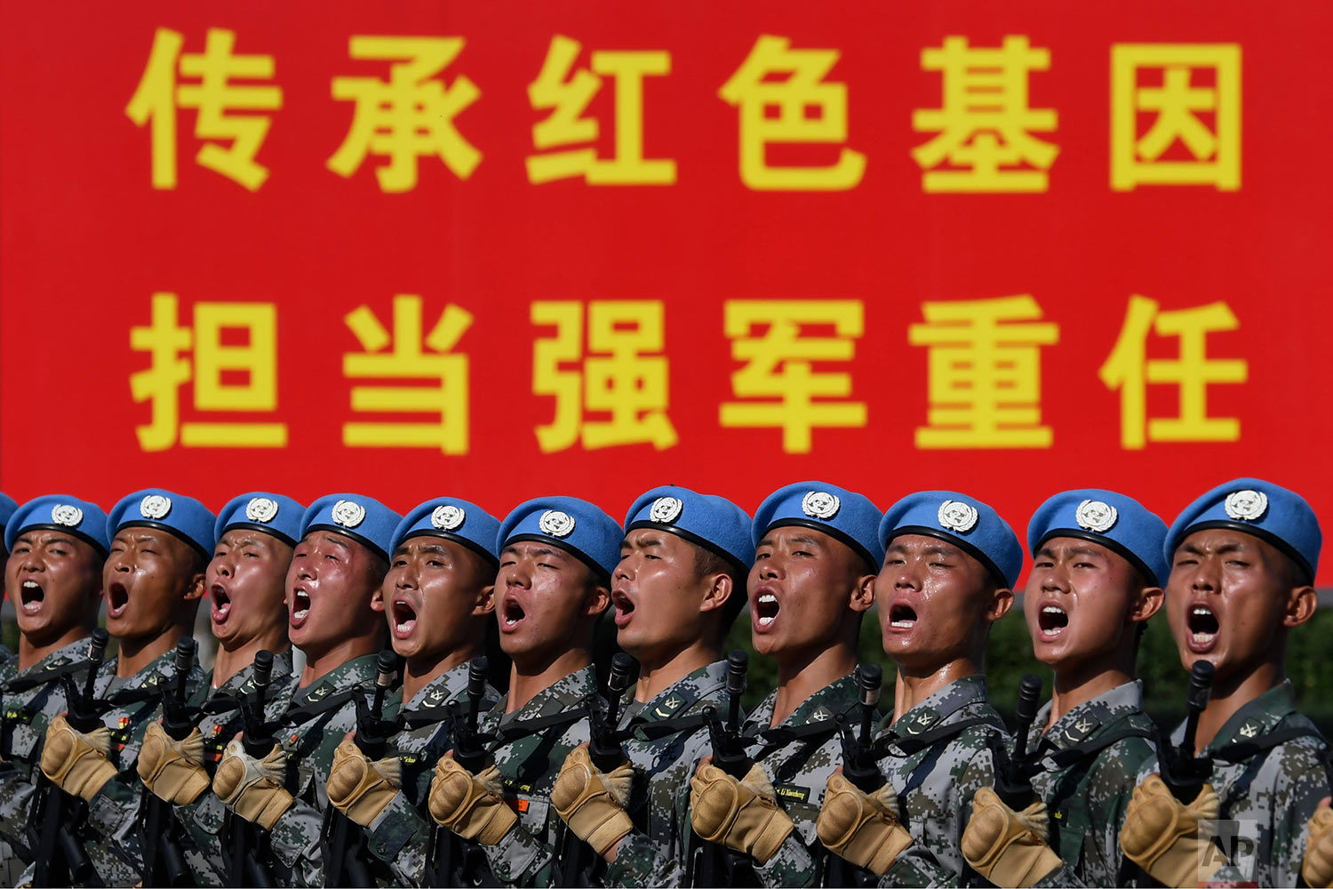 Soldiers practice marching in formation ahead of the military parade to celebrate the 70th anniversary of the founding of the People's Republic of China in Beijing, Wednesday, Sept. 25, 2019. (Naohiko Hatta/Pool Photo via AP)