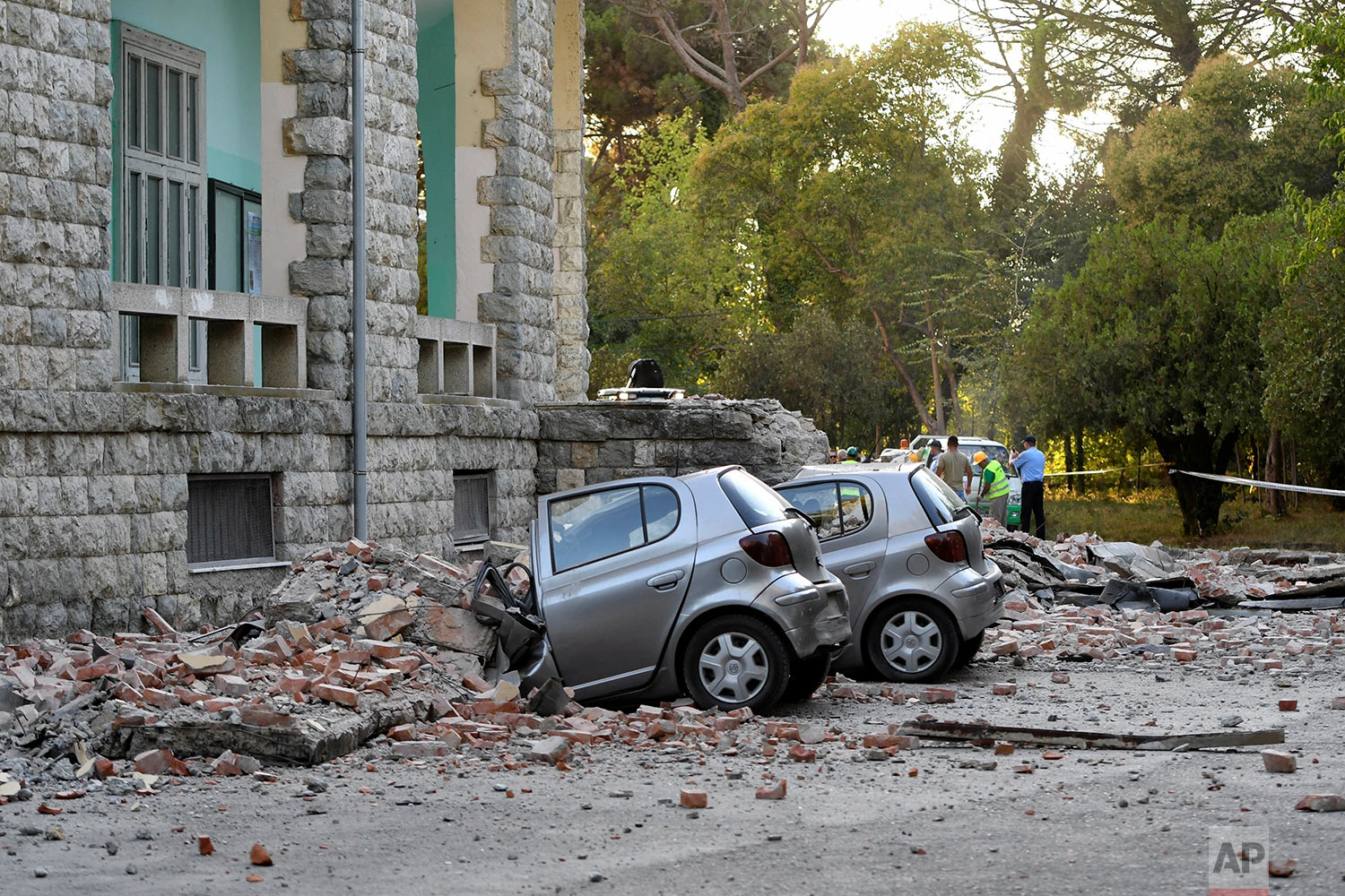 Damaged cars sit outside the Faculty of Geology building after an earthquake in Tirana, Saturday, Sept. 21, 2019. Albania's government and news reports say an earthquake with a preliminary magnitude of 5.8 shook in the country's west and injured at least two people. (AP Photo/Hektor Pustina)