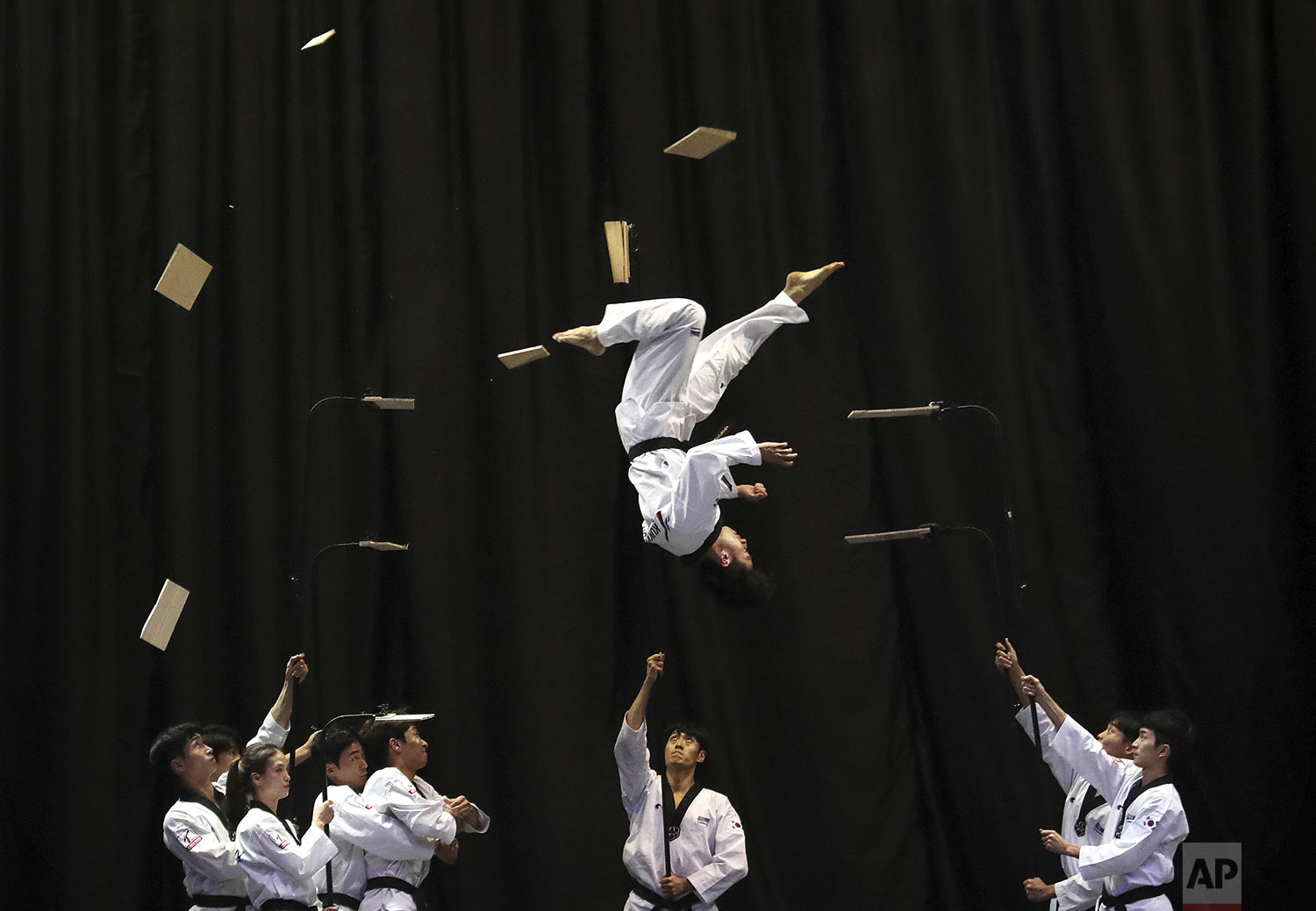 Members of the South Korean Taekwondo demonstration team perform during a visit by Bulgarian Prime Minister Boyko Borisov at Kukkiwon, the headquarters and academy of World Taekwondo, in Seoul, South Korea, Wednesday, Sept. 25, 2019. (AP Photo/Ahn Young-joon)