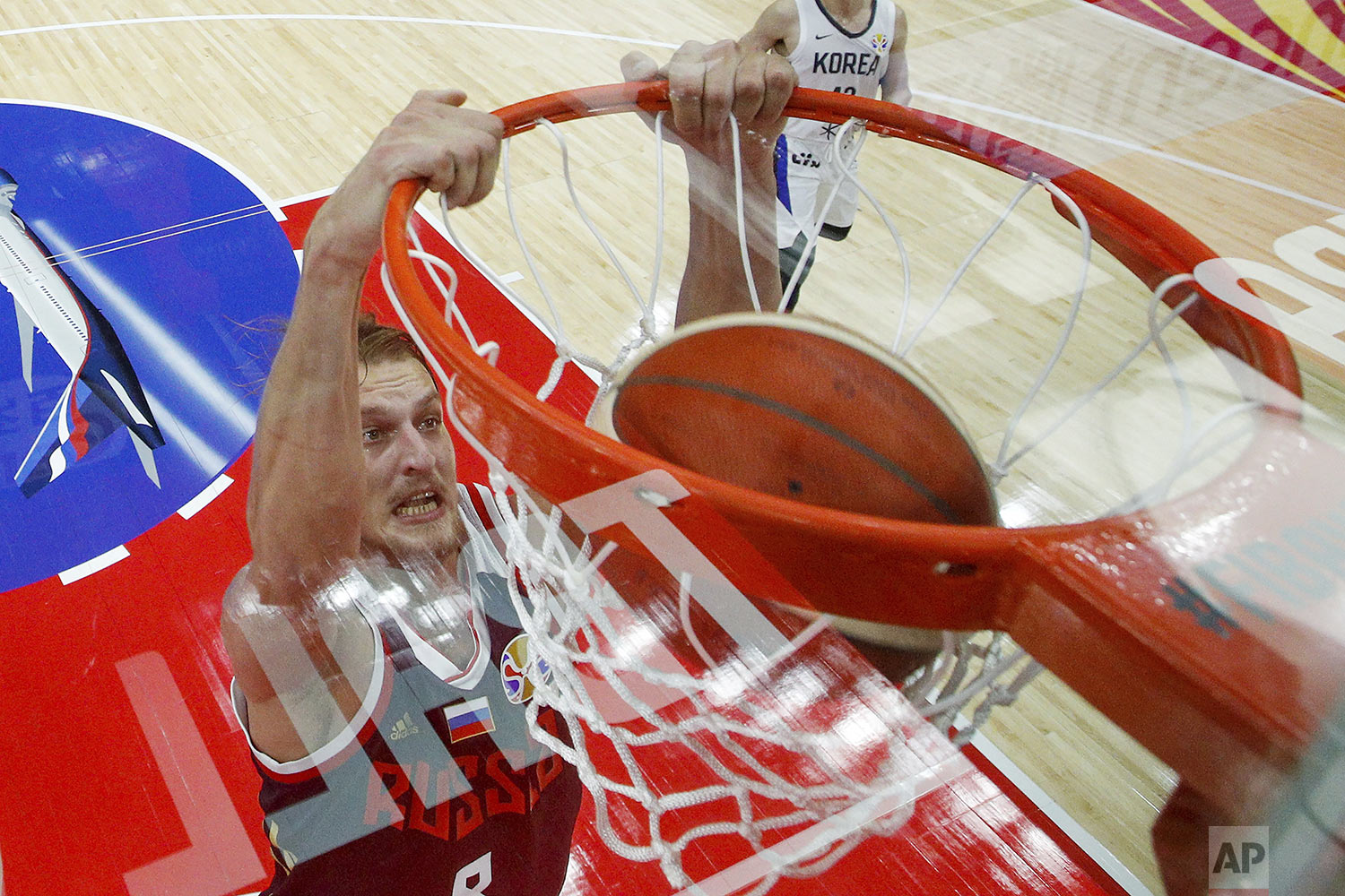 Vladimir Ivlev, of Russia, dunks the ball during the group B game against South Korea in the FIBA Basketball World Cup, at the Sport Center in Wuhan in central China's Hubei province, Monday, Sept. 2, 2019. (AP Photo/Andy Wong)