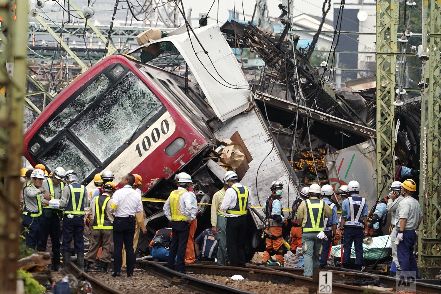 The Keikyu express train sits derailed after its collision with a truck in Yokohama, south of Tokyo Thursday, Sept. 5, 2019. (AP Photo/Eugene Hoshiko)