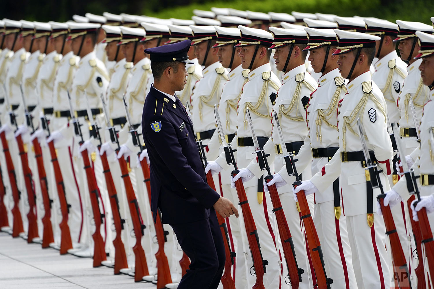 Japanese honor guard members prepare for an inspection by Prime Minister Shinzo Abe and Defense Minister Taro Kono ahead of the Japan Self-Defense Forces senior officers' gathering at Defense Ministry in Tokyo. (AP Photo/Eugene Hoshiko)