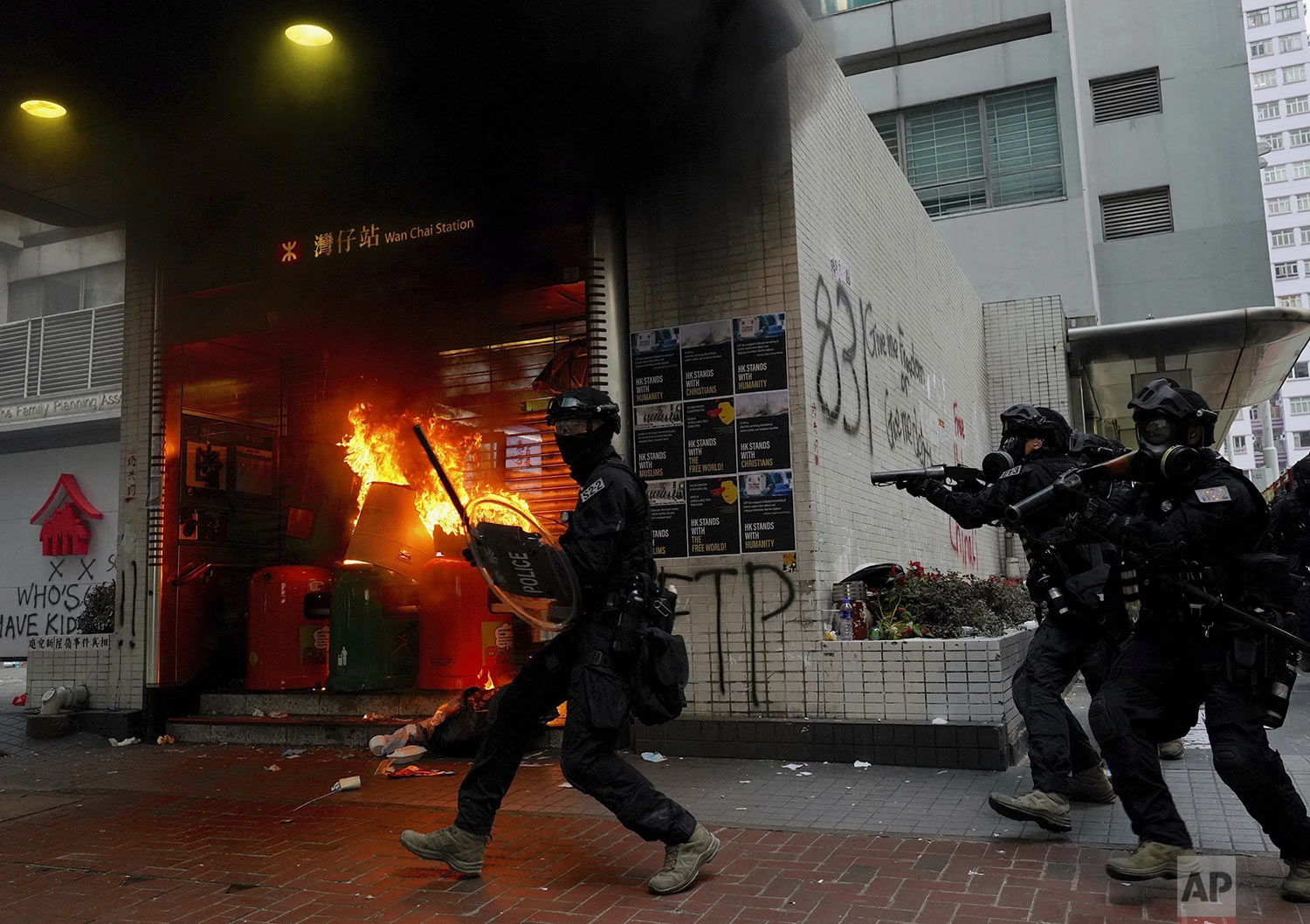 Riot police arrive after protestors vandalized an area in Hong Kong, Sunday, Sept. 29, 2019. (AP Photo/Vincent Yu)