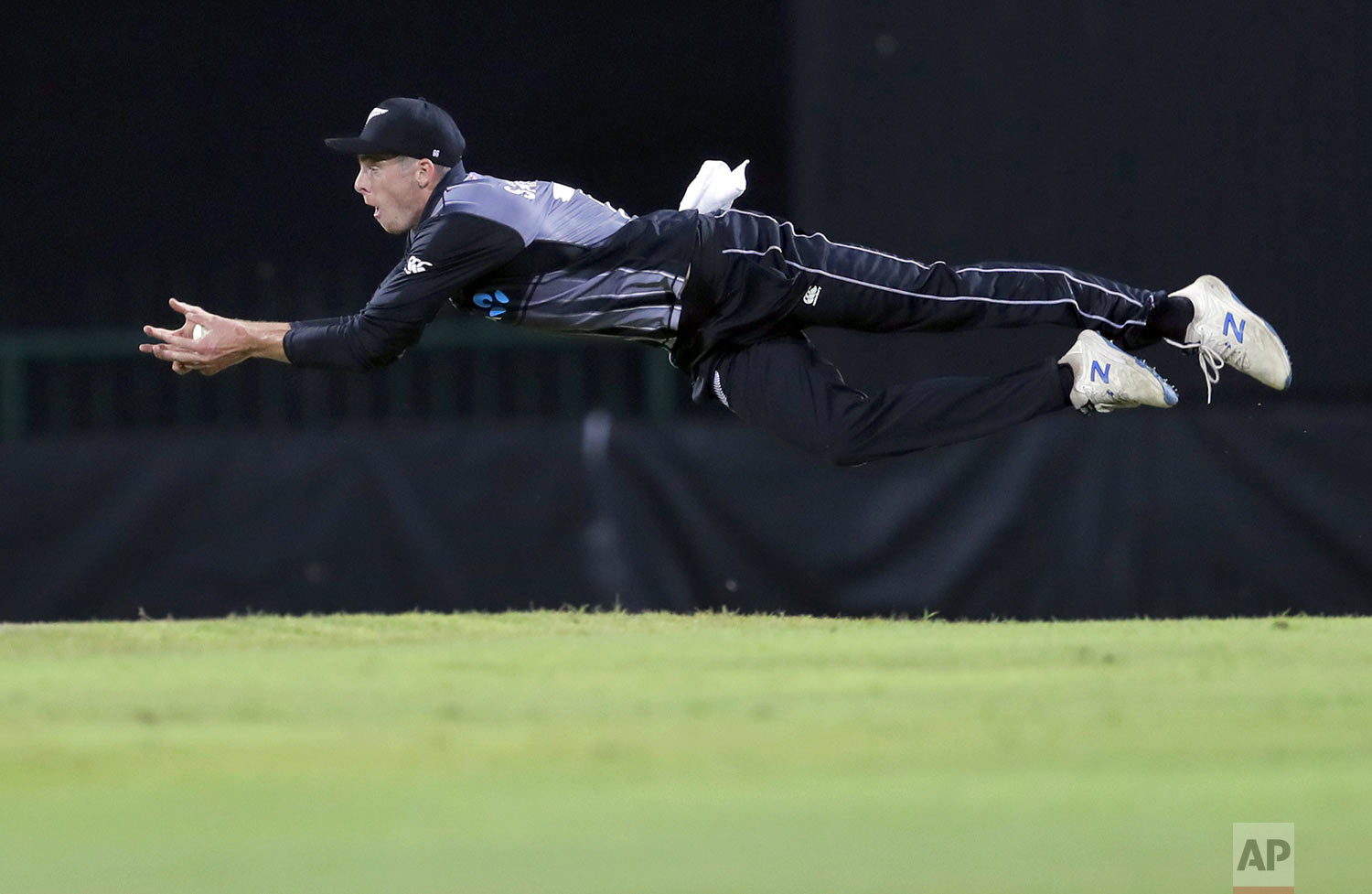 New Zealand's Mitchell Santner successfully takes a catch to dismiss Sri Lanka's Avishka Fernando during the second Twenty20 international cricket match between Sri Lanka and New Zealand in Pallekele, Sri Lanka, Tuesday, Sept. 3, 2019. (AP Photo/Eranga Jayawardena)