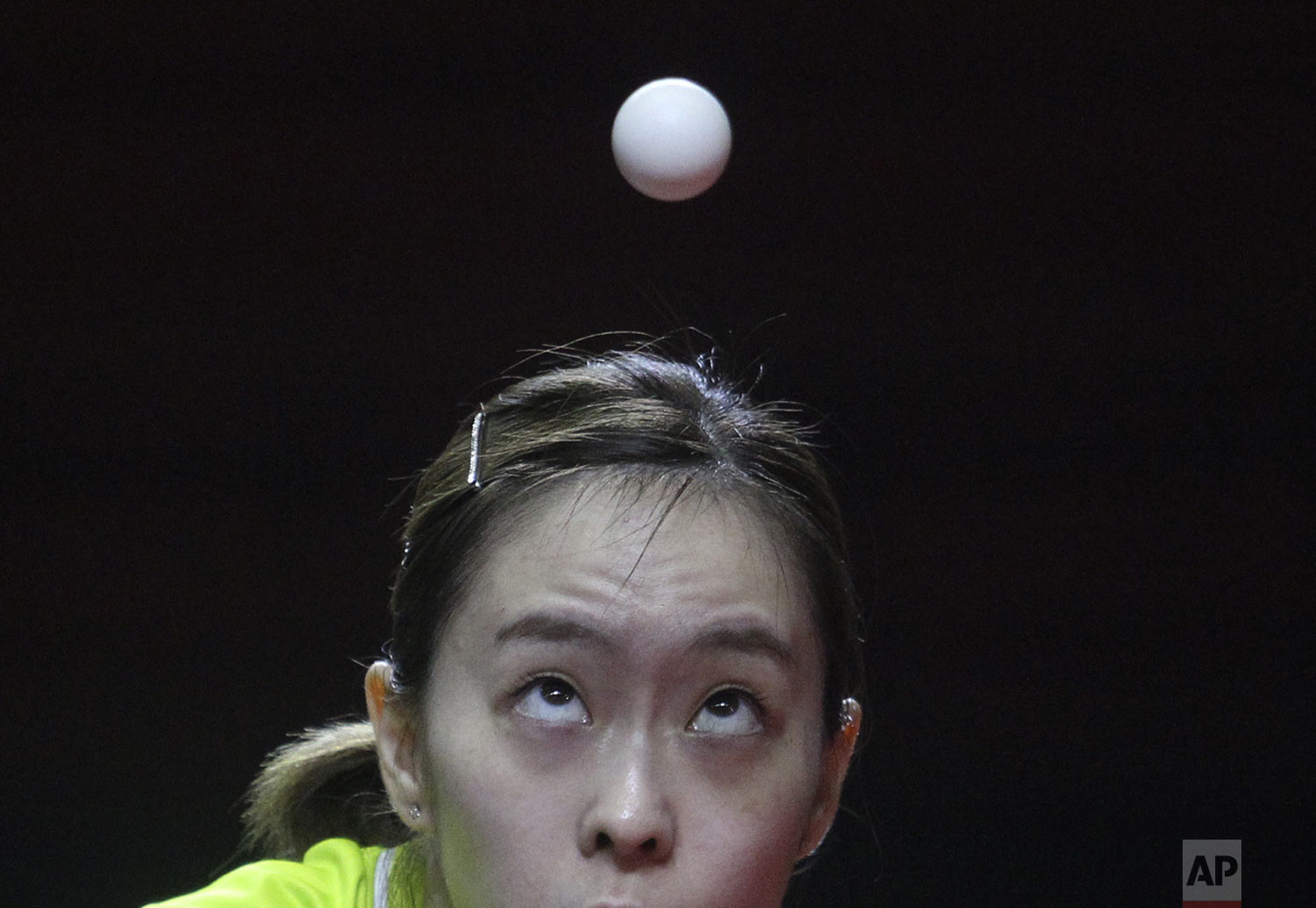 Japan's Kasumi Ishikawa plays against China's Chen Meng during their women's team table tennis final match at the ITTF-ATTU Asian Table Tennis Championships at Amongrogo stadium in Yogyakarta, Central Java, Indonesia, Tuesday, Sept. 17, 2019. (AP Photo/Kalandra)
