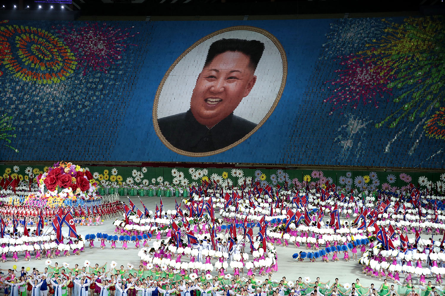 "Performers hold up cards to form a portrait of North Korean leader Kim Jong Un during a mass games performance titled ""The Land of the People"" at May Day Stadium in Pyongyang, North Koreai, Wednesday, Sept. 11, 2019. (AP Photo/Dita Alangkara)"
