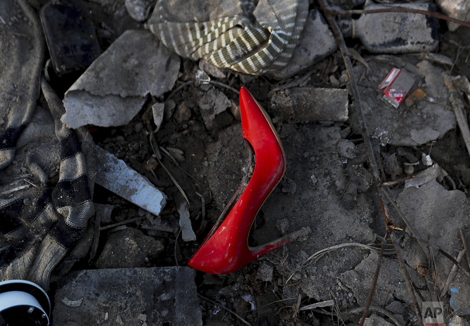 A abandoned high heel shoe lays in the mud in the aftermath of Hurricane Dorian in an area called The Mudd, in Marsh Harbor, Abaco Island, Bahamas, Sunday, Sept. 8, 2019. Dorian was the most powerful hurricane in the northwestern Bahamas' recorded history. (AP Photo/Fernando Llano)