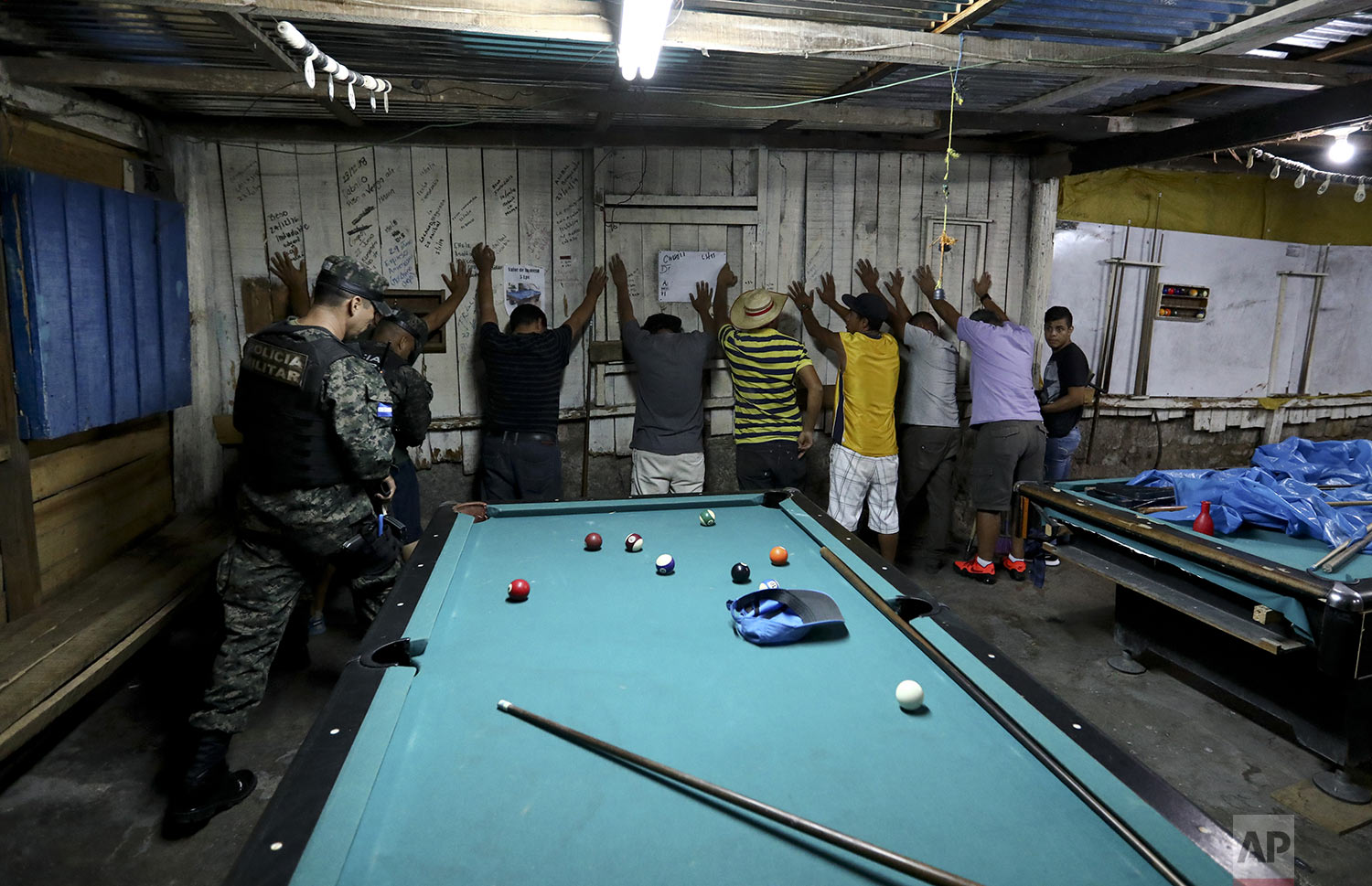 Soldiers enter a pool hall during their routine patrol in Tegucigalpa, Honduras, Wednesday, Aug. 21, 2019. Ironically, the extradition of drug capos to the U.S. under Honduran President Juan Orlando Hernández could have helped build the case against his own brother, in which he is now implicated. (AP Photo/Eduardo Verdugo)