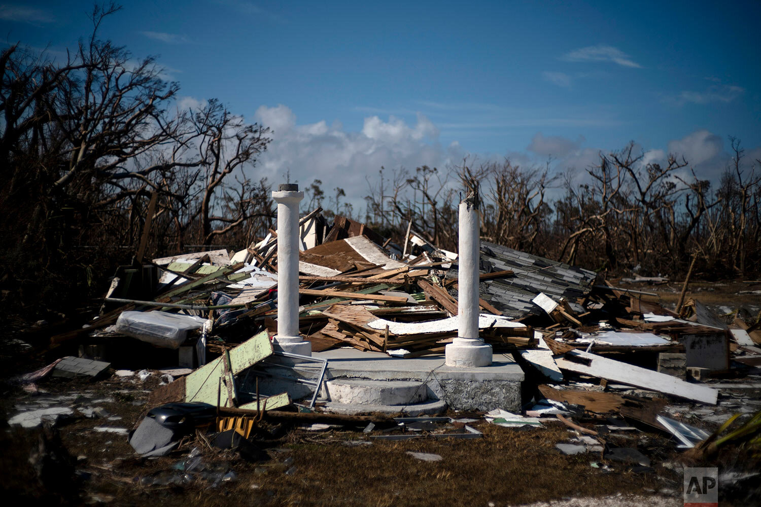 The portico of a house destroyed by Hurricane Dorian is the only thing that stands of the structure, destroyed by Hurricane Dorian, in High Rock, Grand Bahama, Bahamas, Thursday Sept. 5, 2019. (AP Photo/Ramon Espinosa)