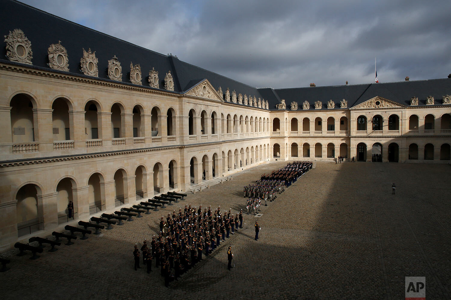 Members of the Republican Guard line up in the Invalides monument courtyard in Paris, Monday, Sept. 30, 2019. Past and current heads of states are gathered in Paris to pay tribute to former French President Jacques Chirac. He died at the age of 86. (AP Photo/Thibault Camus)