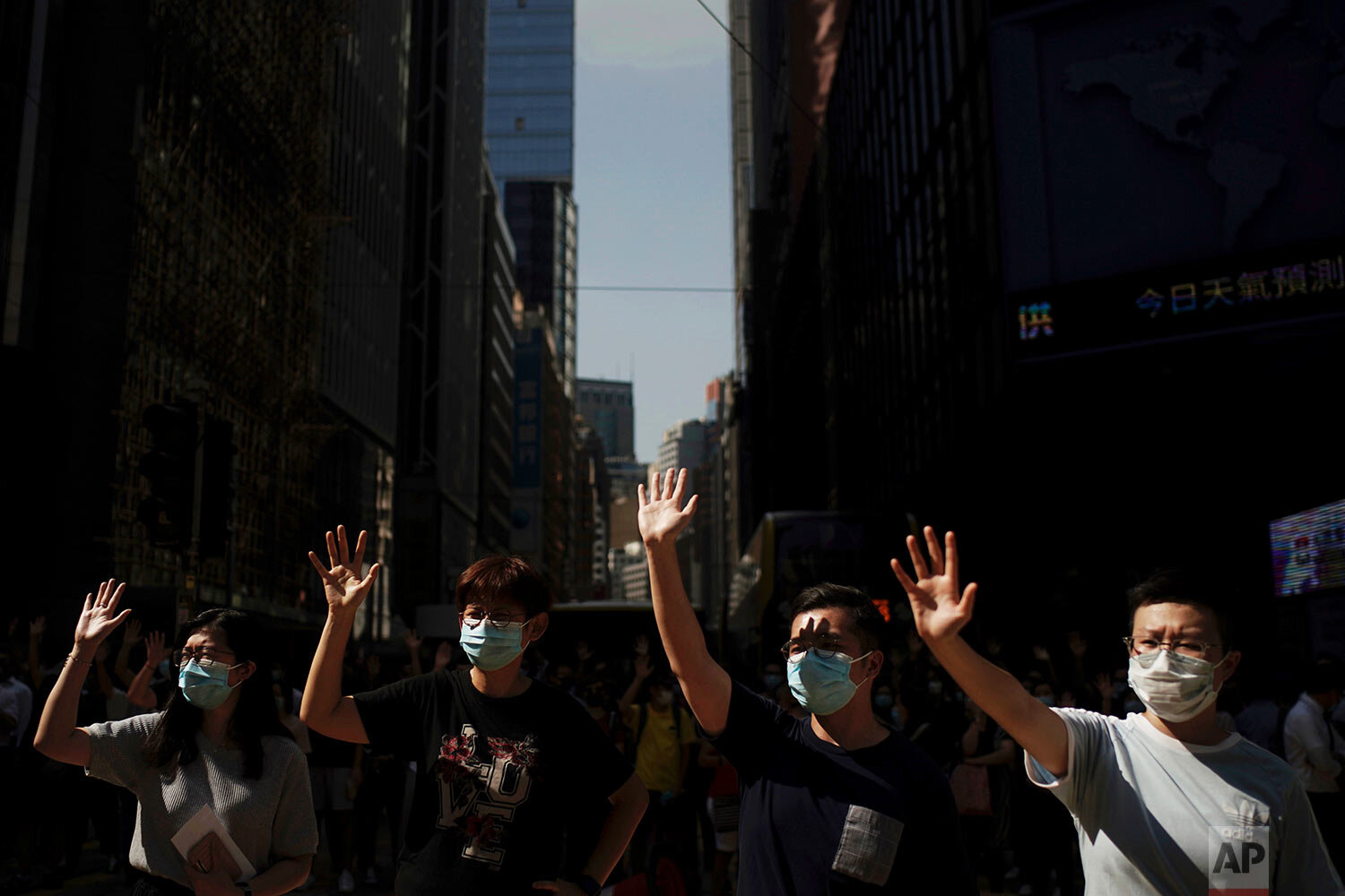 Pro-democracy protesters march in the city center ahead of reported plans by the city's embattled leader to deploy emergency powers to ban people from wearing masks in a bid to quash four months of anti-government demonstrations, Friday, Oct. 4, 2019, in Hong Kong. (AP Photo/Felipe Dana)