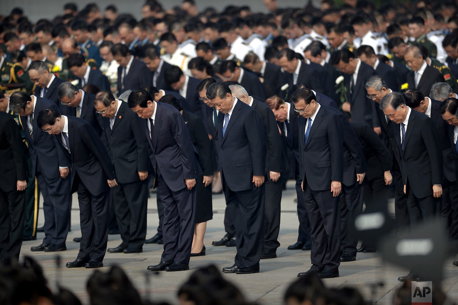 Chinese President Xi Jinping, center, and other officials bow during a ceremony to mark Martyr's Day at Tiananmen Square in Beijing, Monday, Sept. 30, 2019. Xi led other top officials in paying respects to the founder of the communist state Mao Zedong ahead of a massive celebration of the People's Republic's 70th anniversary. (AP Photo/Mark Schiefelbein, Pool)