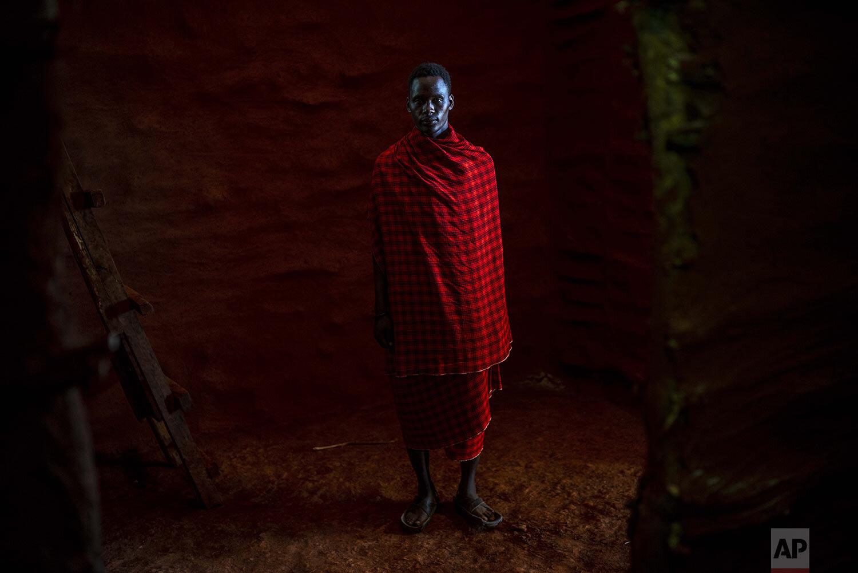 Saitoti Petro poses for a portrait near the village of Narakauwo, Tanzania, Thursday July 4, 2019. (AP Photo/Jerome Delay)