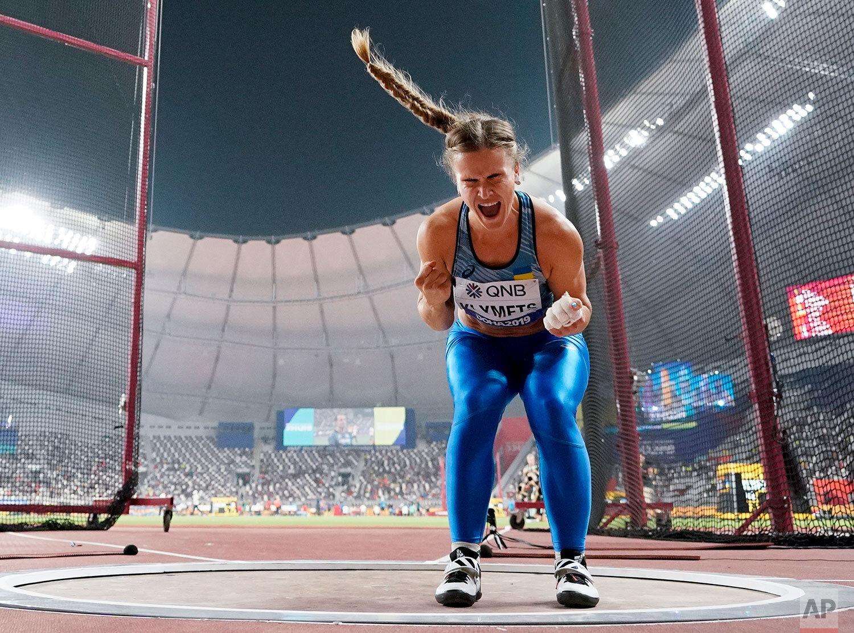 Iryna Klymets, of Ukraine, celebrates during the women's hammer throw final at the World Athletics Championships in Doha, Qatar, Saturday, Sept. 28, 2019. (AP Photo/David J. Phillip)