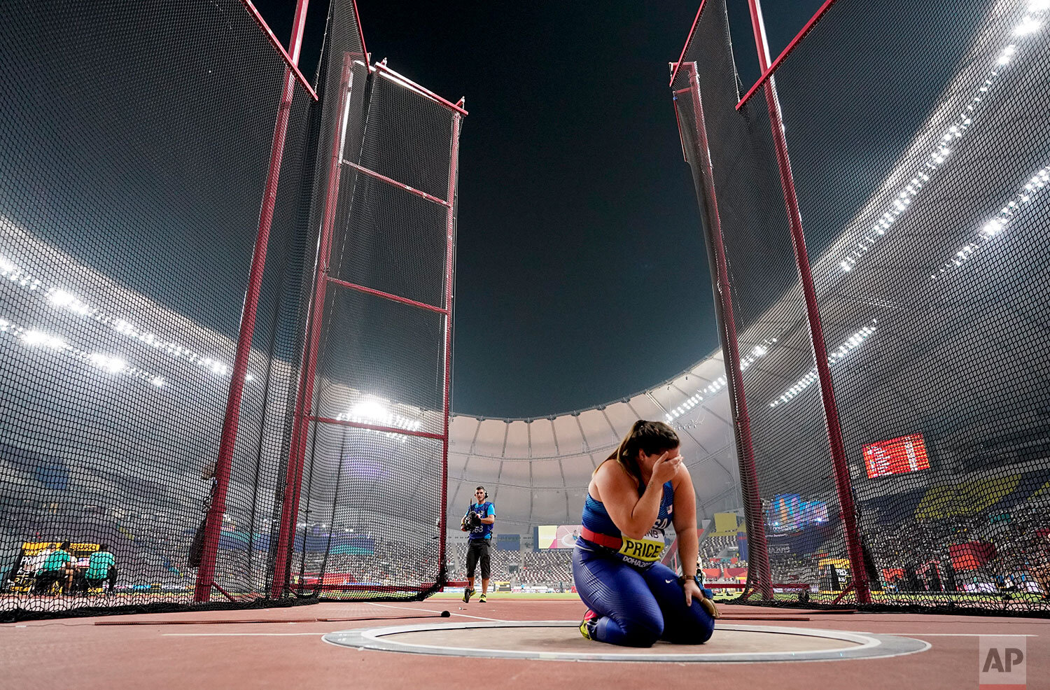 Deanna Price, of the United States, celebrates winning the gold medal for the women's hammer throw at the World Athletics Championships in Doha, Qatar, Saturday, Sept. 28, 2019. (AP Photo/David J. Phillip)