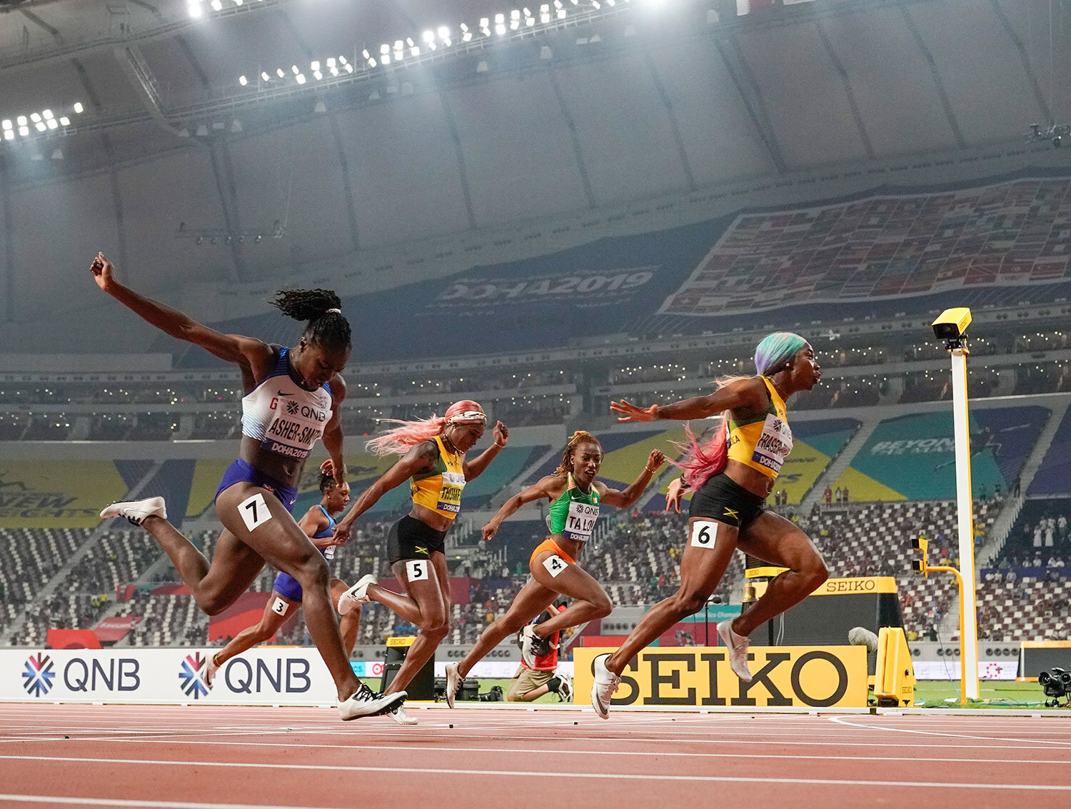 Shelly-Ann Fraser-Pryce (6), of Jamaica, finishes ahead of Dina Asher-Smith (7), of Great Britain, and Marie-Josée Ta Lou (4), of The Ivory Coast, in the women's 100-meter final at the World Athletics Championships in Doha, Qatar, Sunday, Sept. 29, 2019. (AP Photo/David J. Phillip)