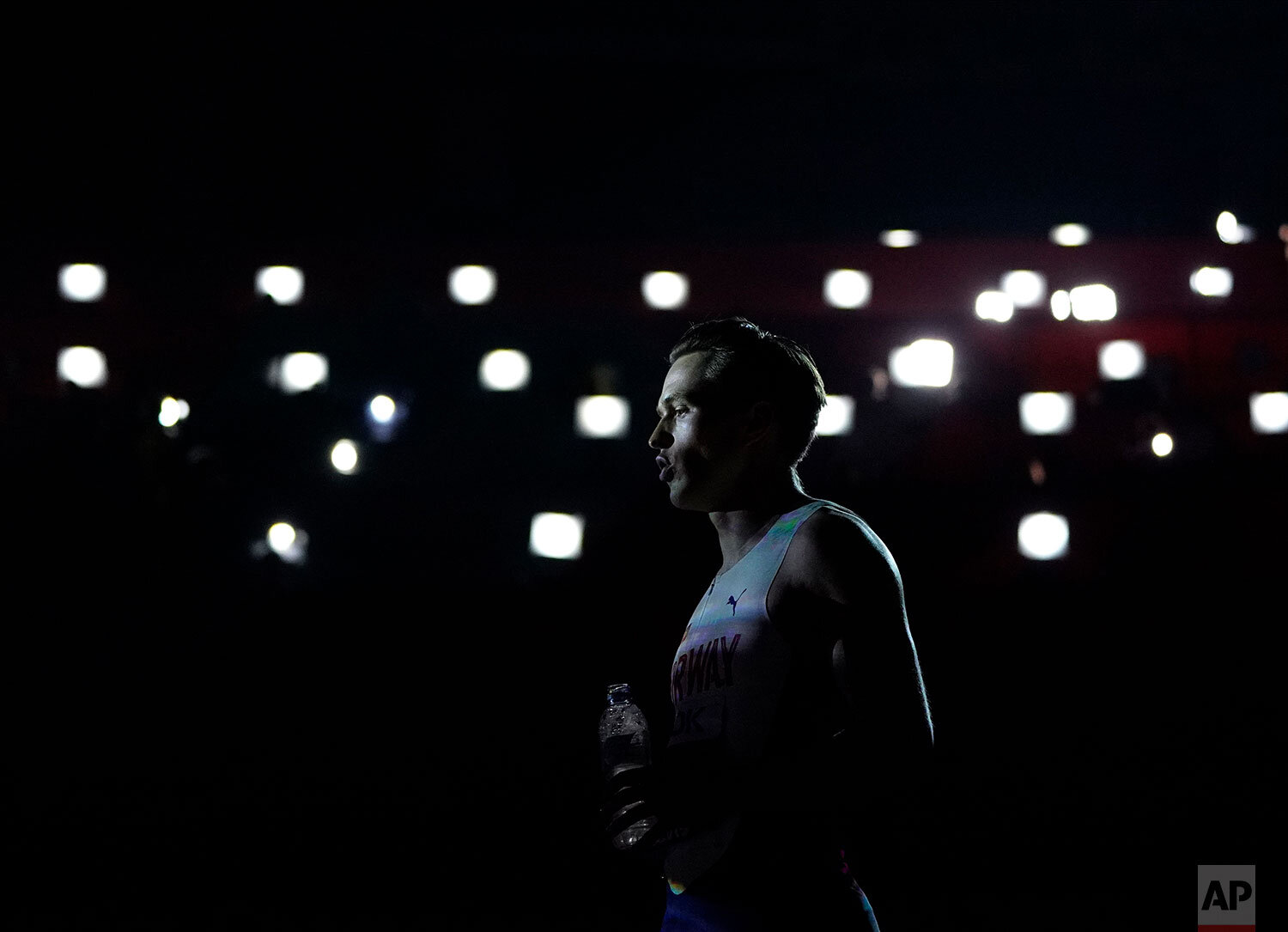 Karsten Warholm, of Norway, stands in front of lights at the start of the men's 400 meter hurdles final at the World Athletics Championships in Doha, Qatar, Monday, Sept. 30, 2019. Warholm won the gold medal in the event. (AP Photo/David J. Phillip)