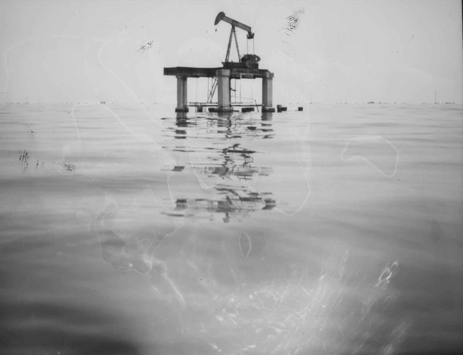 In this July 8, 2019 photo, an abandoned state-run PDVSA oil platform on Lake Maracaibo at Cabimas, Venezuela. (AP Photo/Rodrigo Abd)