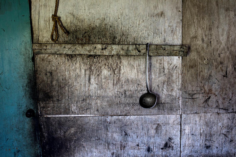 A spoon hangs inside a fisherman's kitchen covered in crude oil in Cabimas, Venezuela, July 4, 2019. (AP Photo/Rodrigo Abd)