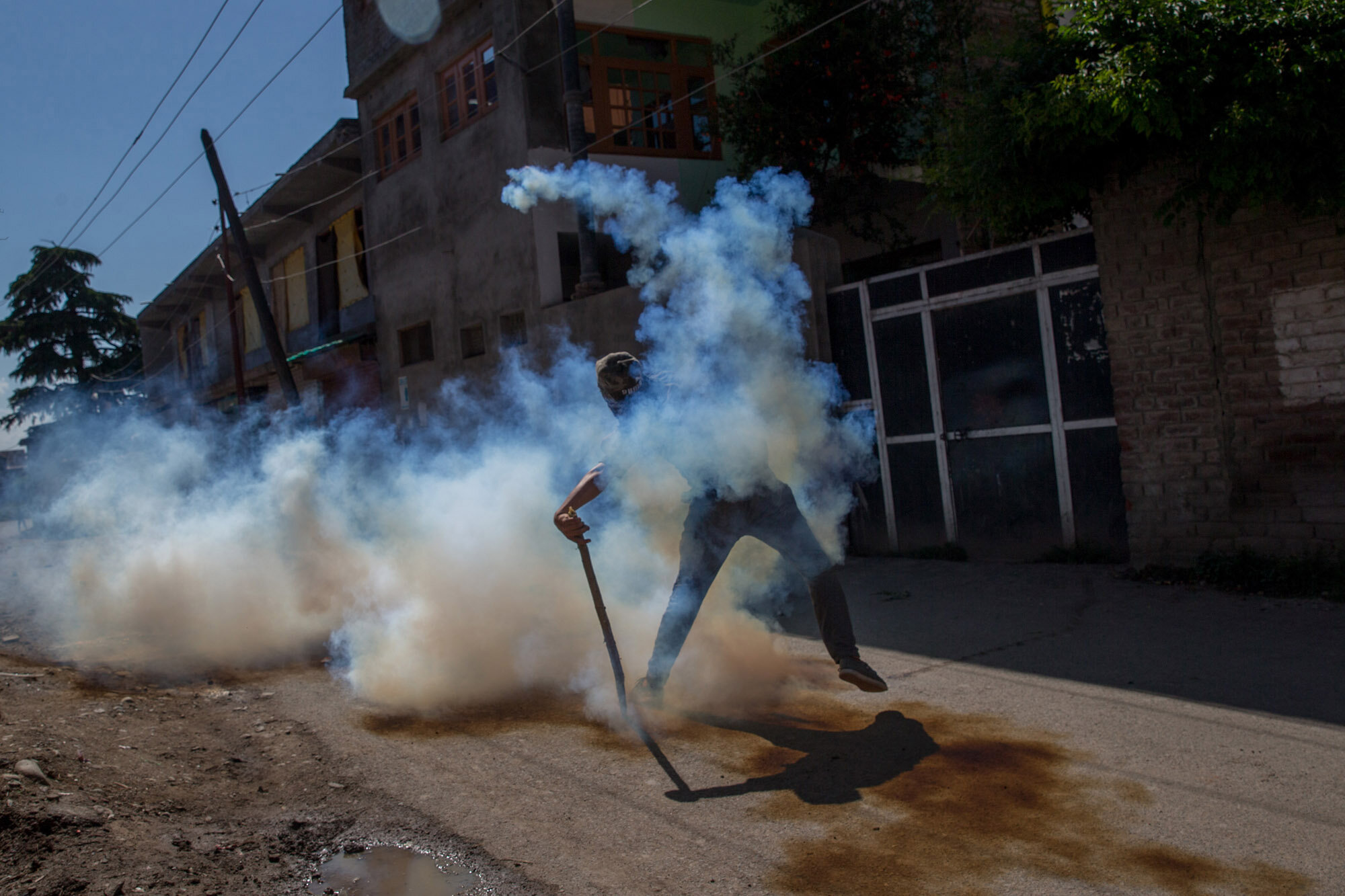 A Kashmiri protester throws exploded tear gas shell back at Indian policemen during a protest in Srinagar, Indian controlled Kashmir, June 9, 2017. (AP Photo/Dar Yasin)
