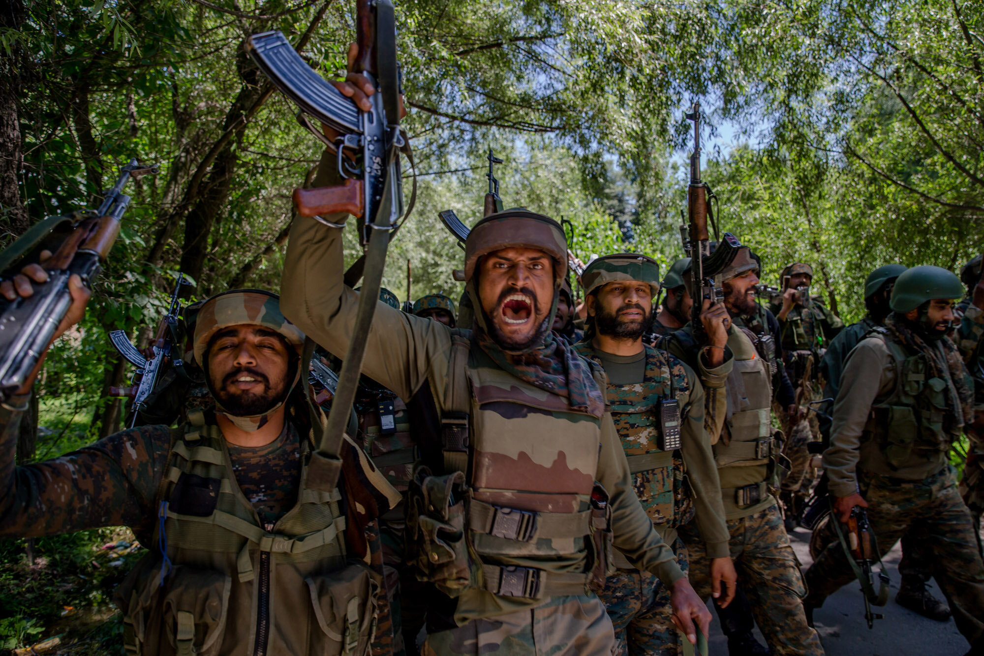 Indian army soldiers shout pro Indian and anti Pakistan slogans as they leave the site of gun-battle in Dialgham about 60 Kilometres South Srinagar, Indian controlled Kashmir, July 1, 2017. (AP Photo/Dar Yasin)