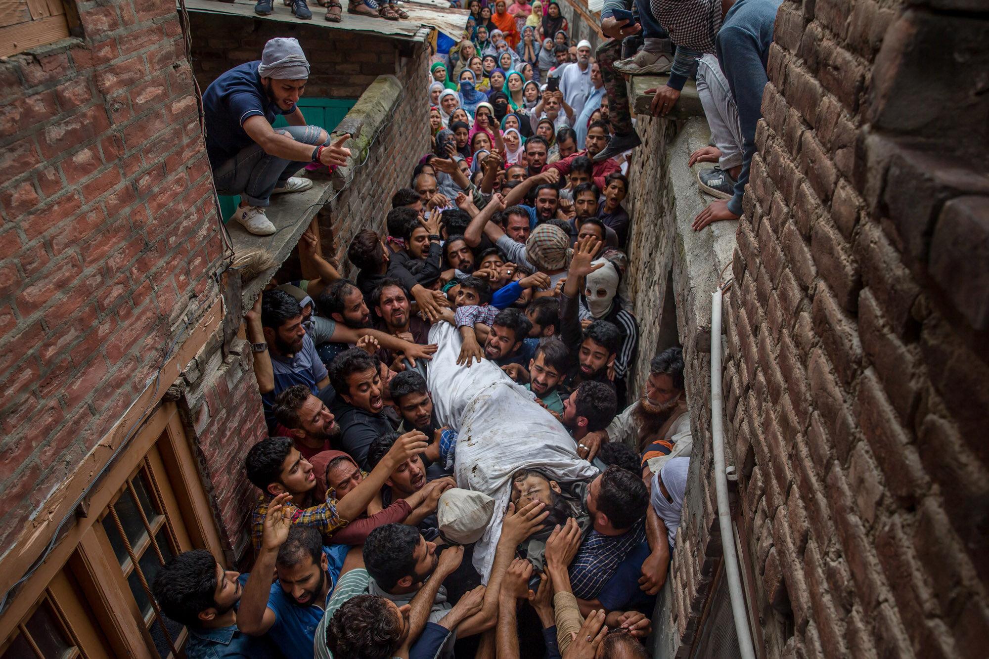 Kashmiri men shout pro-freedom slogans as they carry body of a local rebel Sajad Ahmed Gilkar, during his funeral in Srinagar, Indian controlled Kashmir, July 12, 2017. (AP Photo/Dar Yasin)
