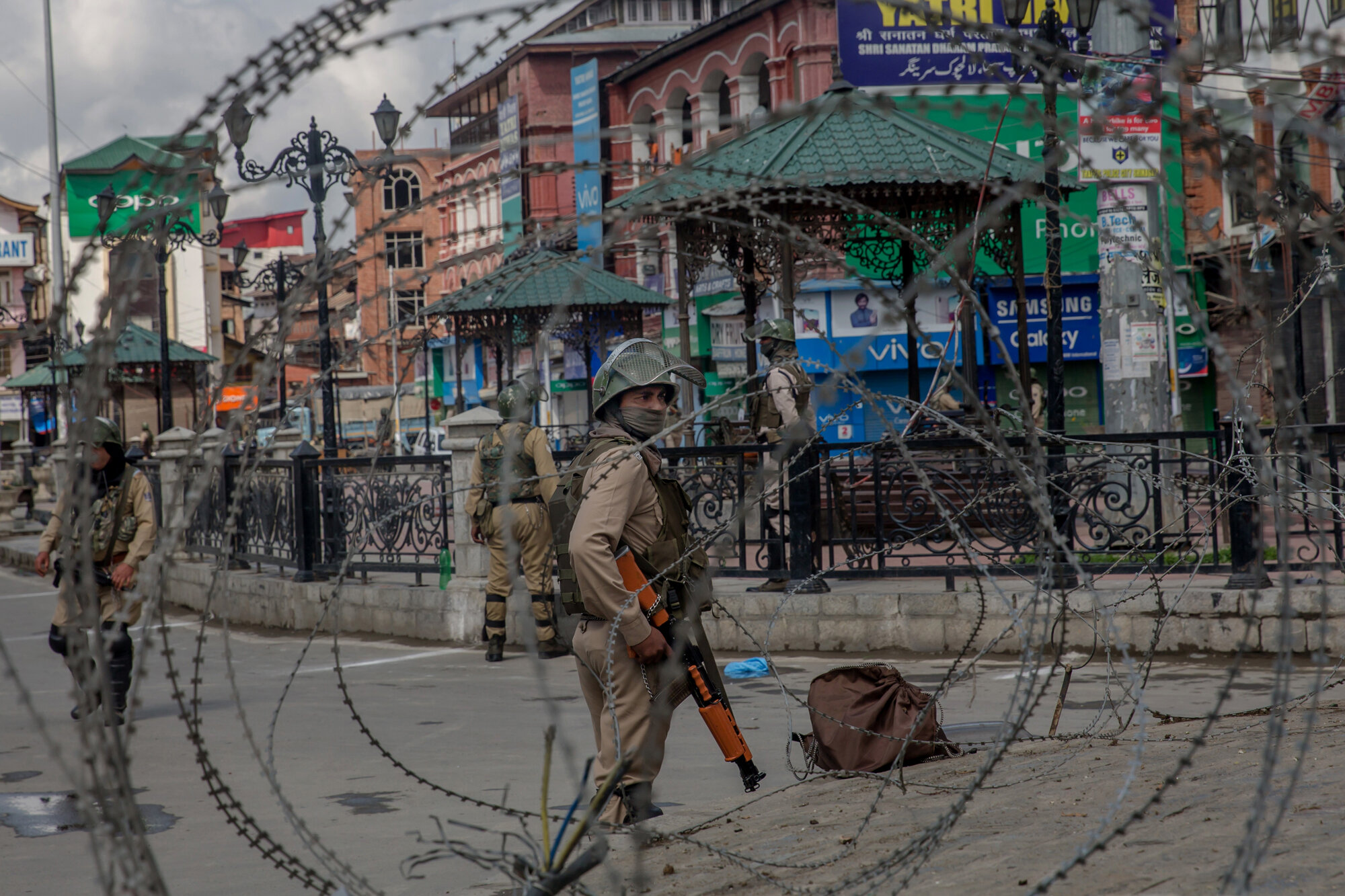Indian Paramilitary soldiers are seen through barbed wire during strike in Srinagar, Indian controlled Kashmir, Saturday, May 19, 2018. (AP Photo/Dar Yasin)