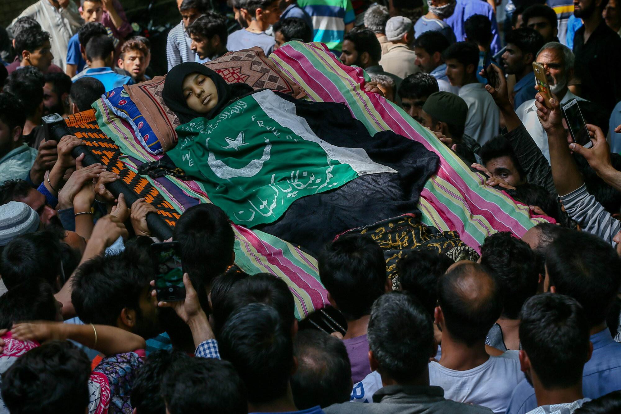 Kashmiri villagers carry body of Andleeb, a13 year old Kashmiri girl during the joint funeral procession in Hawoorah village some 68 Kilometres south of Srinagar, Indian controlled Kashmir, July, 7, 2018. (AP Photo/Dar Yasin)