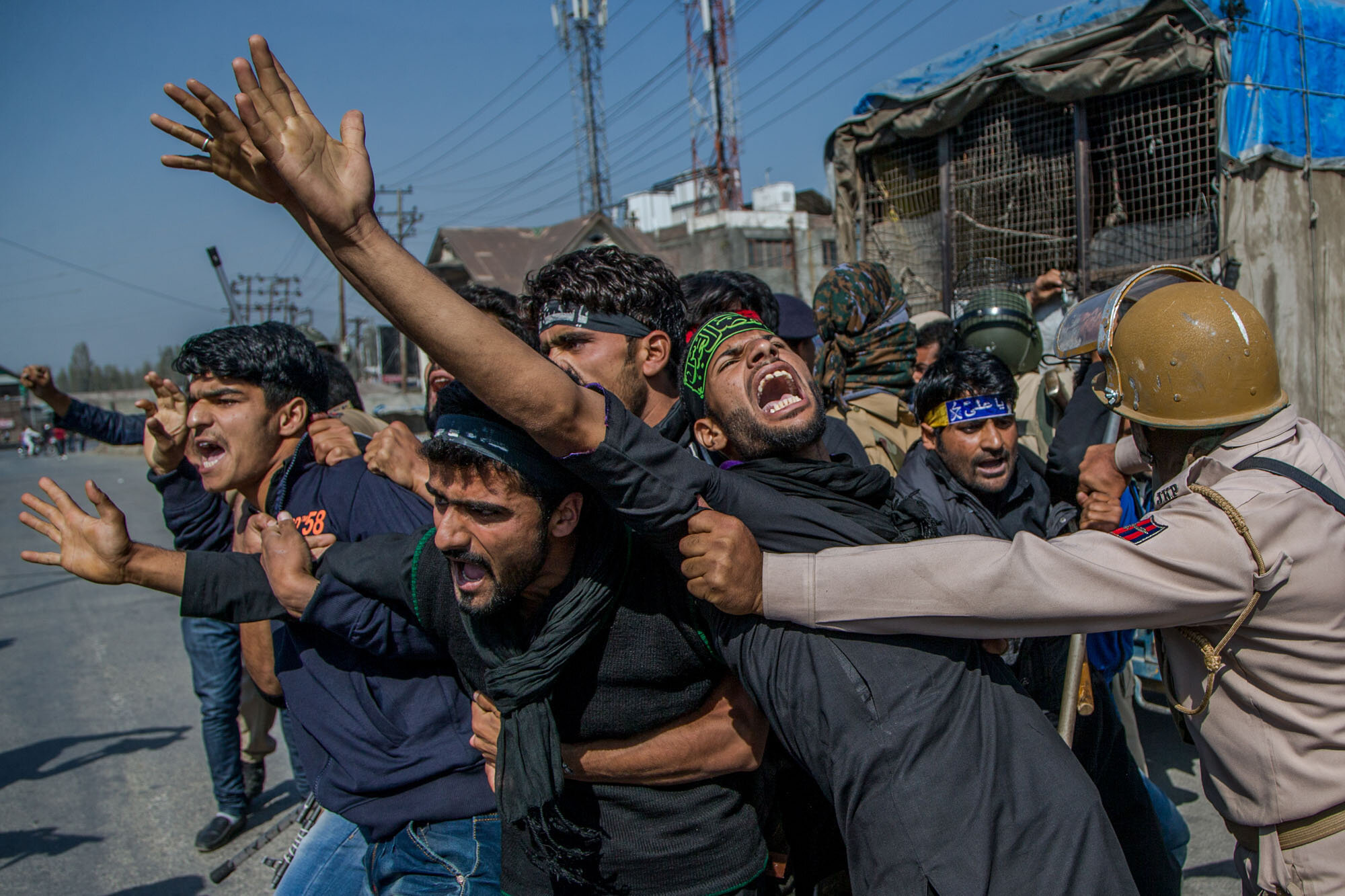 Kashmiri Shiite Muslims shouts religious and pro-freedom slogan as Indian policemen stop them from for participating in a religious procession during curfew in Srinagar, Indian controlled Kashmir, Oct. 10, 2016. (AP Photo/Dar Yasin)