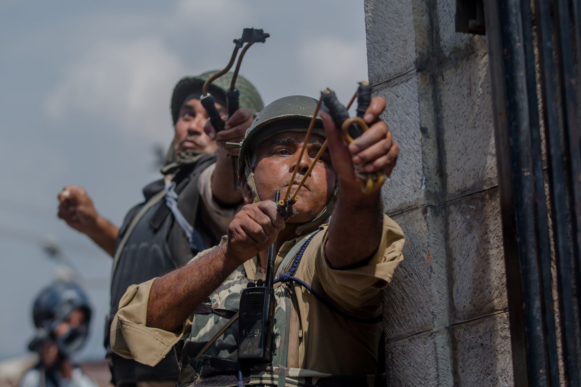 Indian paramilitary soldiers uses slings to shoot glass marbles at Kashmiri protesters in Srinagar, Indian controlled Kashmir, Aug. 4, 2017. (AP Photo/Dar Yasin)