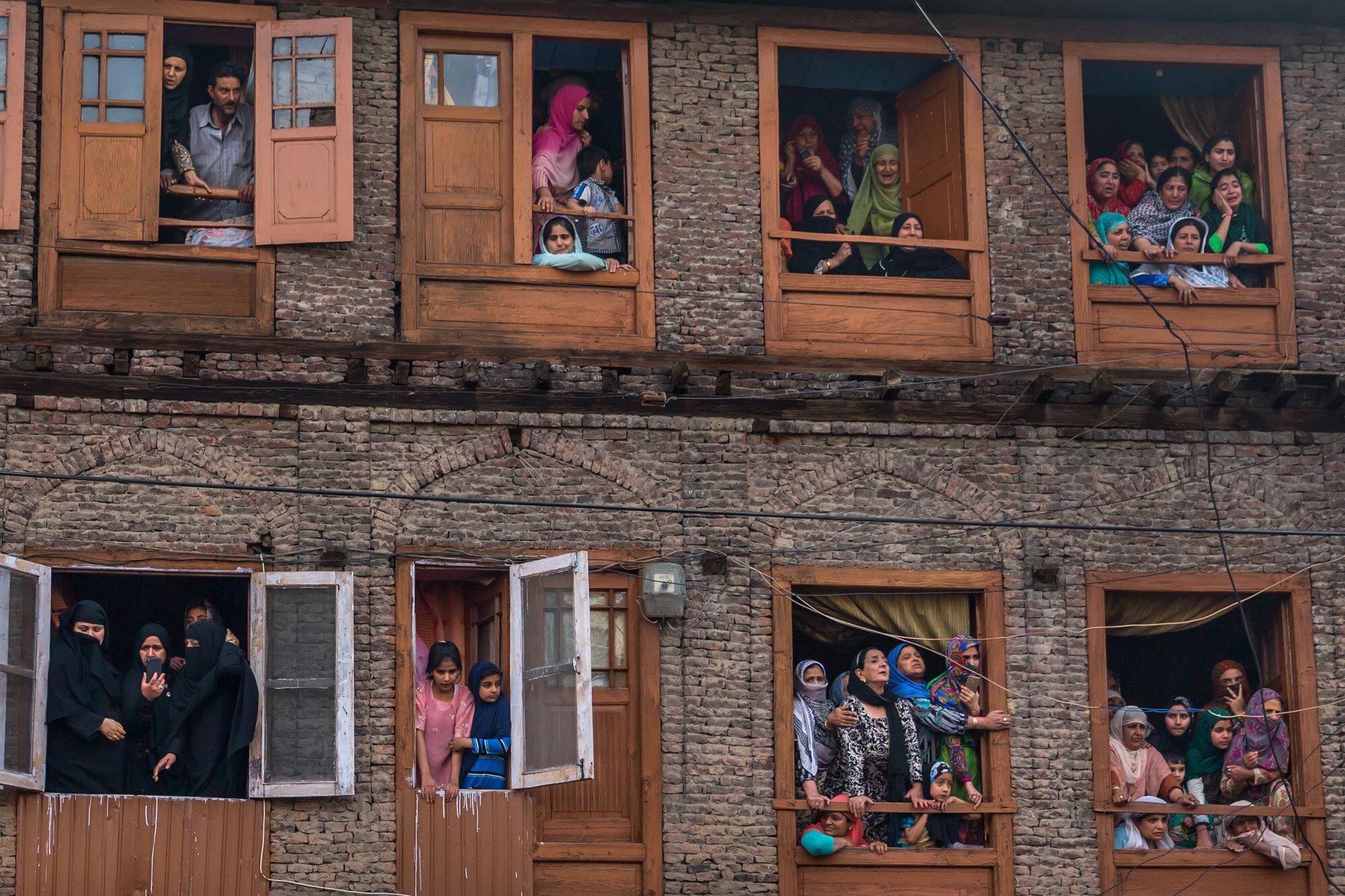 Kashmiri Muslims grieve as they watch funeral procession of Fayaz Ahmad Hamal, in Srinagar, Indian controlled Kashmir, May 5, 2018. (AP Photo/Dar Yasin)