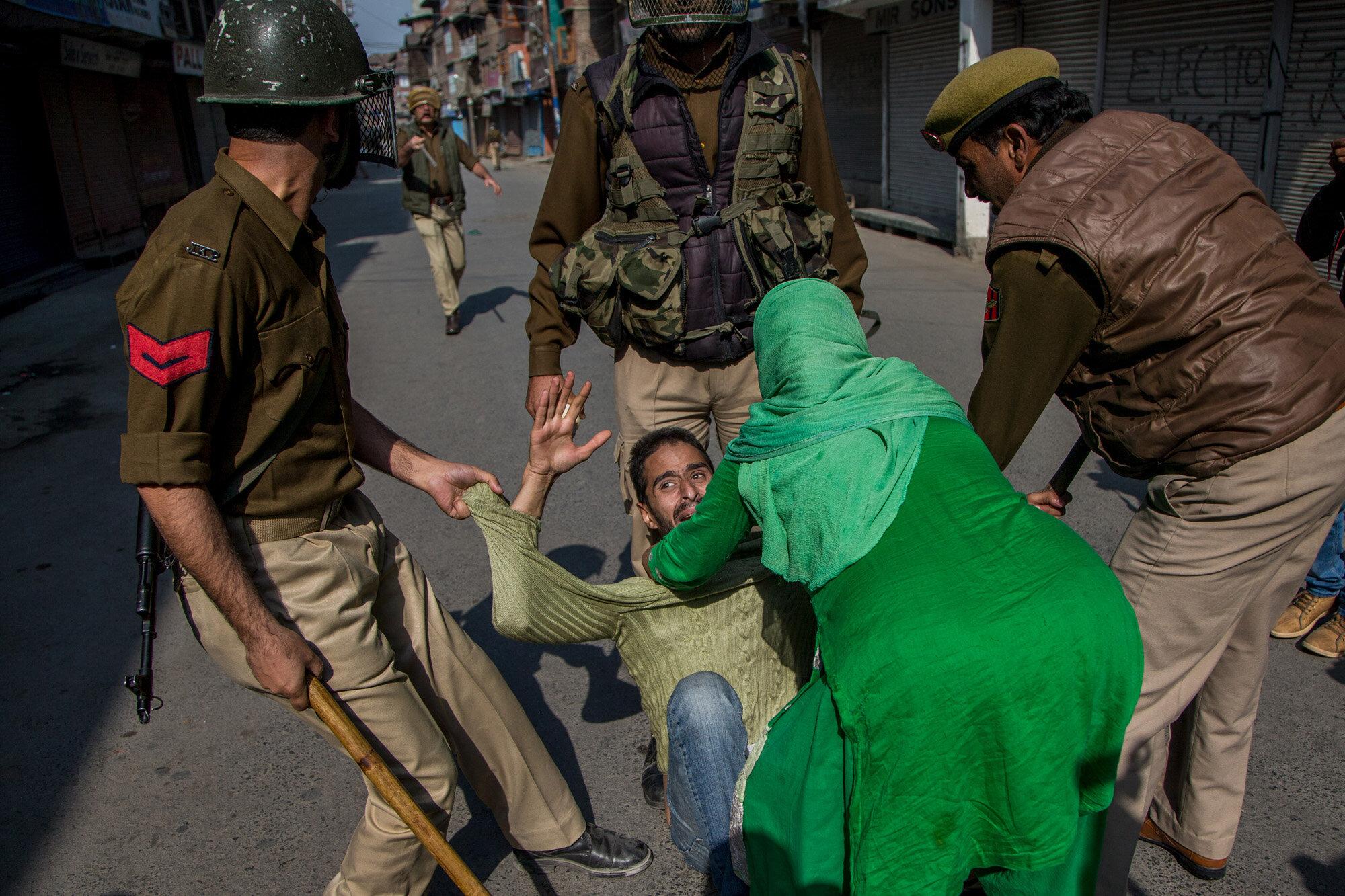 Indian police men try to detain Kashmiri man during a protest in Srinagar, Indian controlled Kashmir, Oct. 22, 2016. (AP Photo/Dar Yasin)