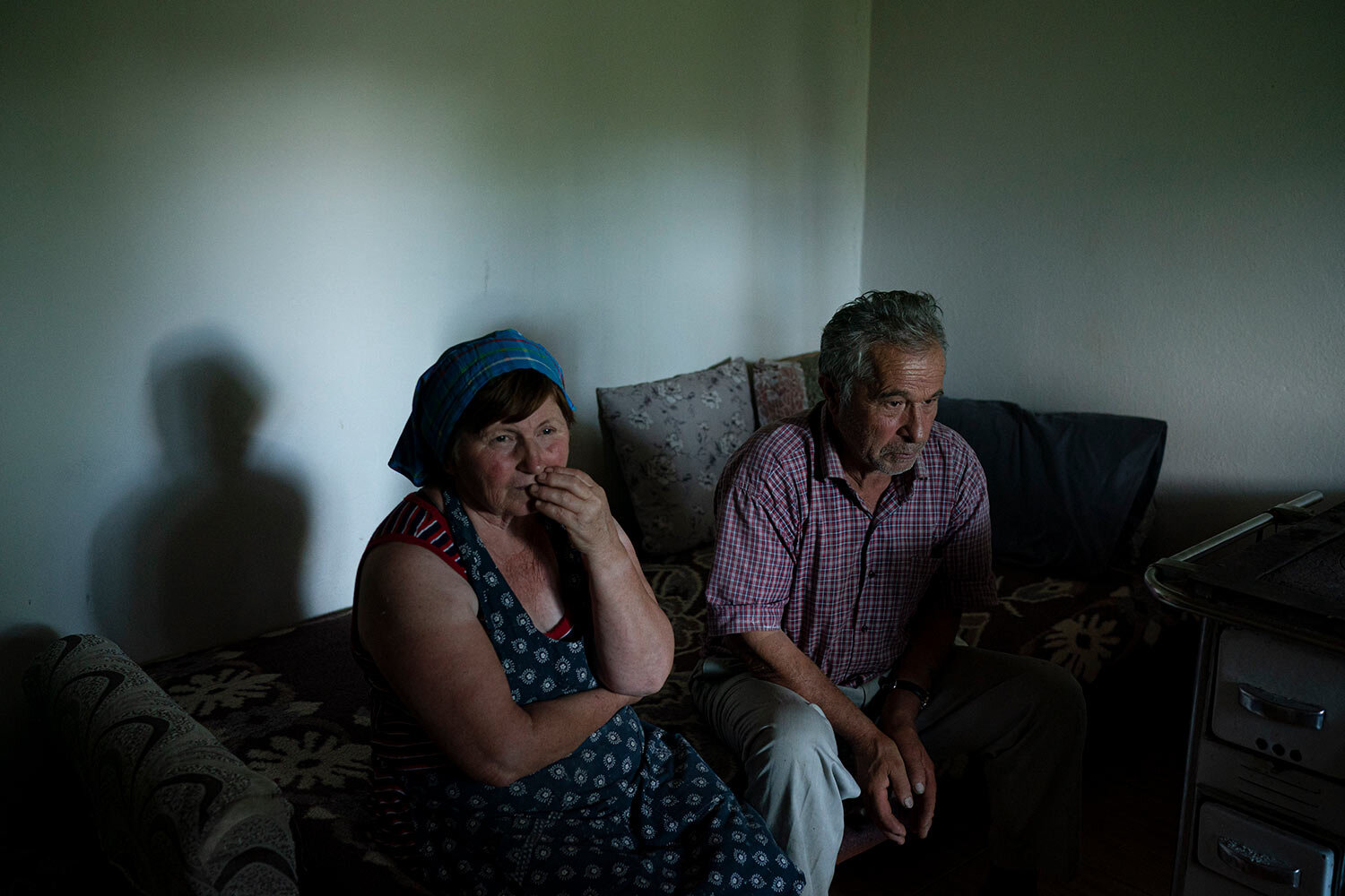 Jorgji Ilia, 71, a retired schoolteacher, sits with his wife, Vito, 64, inside their home in the village of Kanikol, Albania. (AP Photo/Felipe Dana)