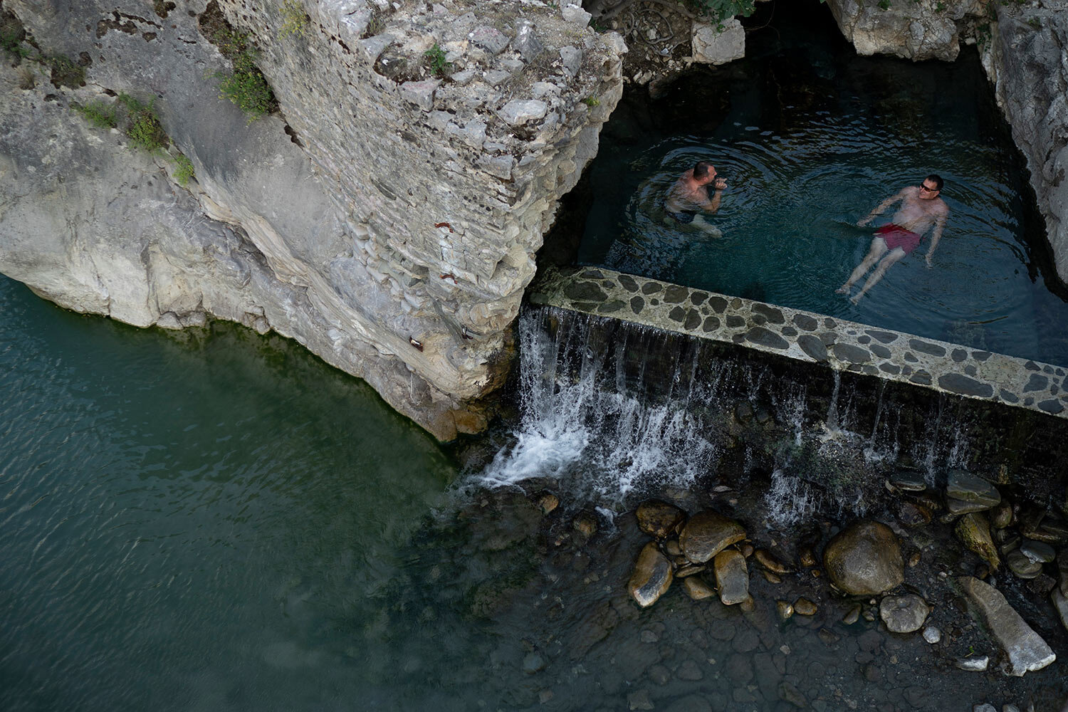 People bathe in a thermal spring on the banks of the Langarica River, a tributary to the Vjosa near Permet, Albania. (AP Photo/Felipe Dana)