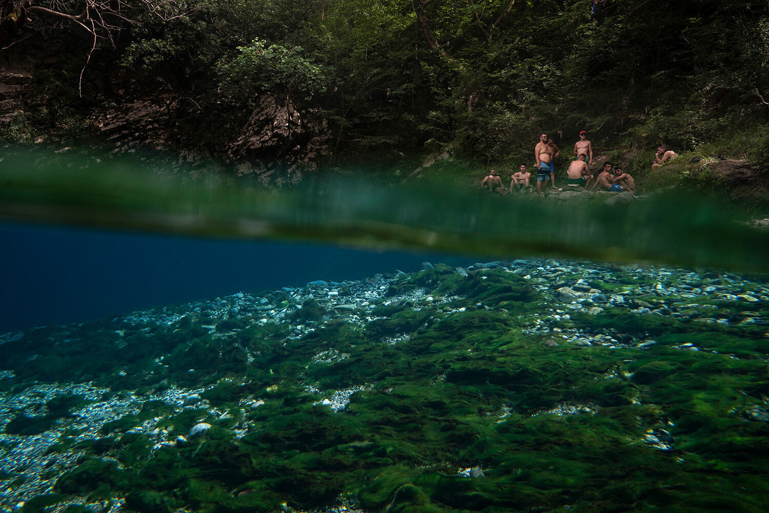 Residents sit on the shore of the Vjosa River next to a spring in the Kelcyre Gorge, Albania. (AP Photo/Felipe Dana)
