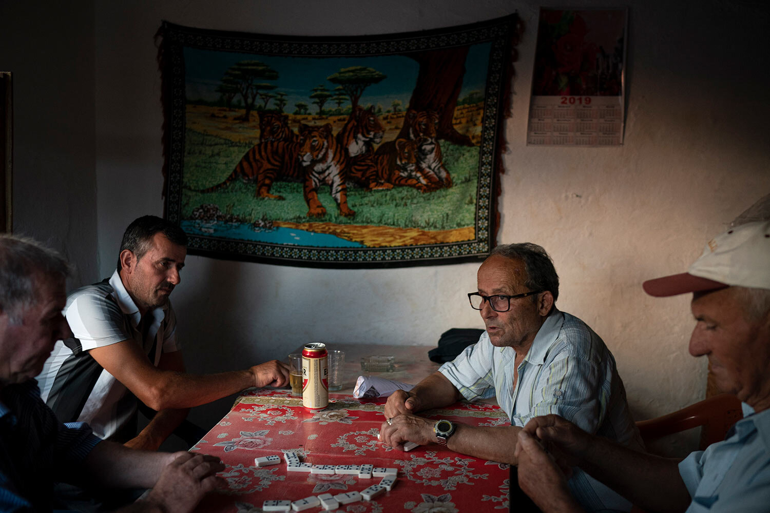Residents play dominoes in a small bar in the village of Kute, Albania. (AP Photo/Felipe Dana)