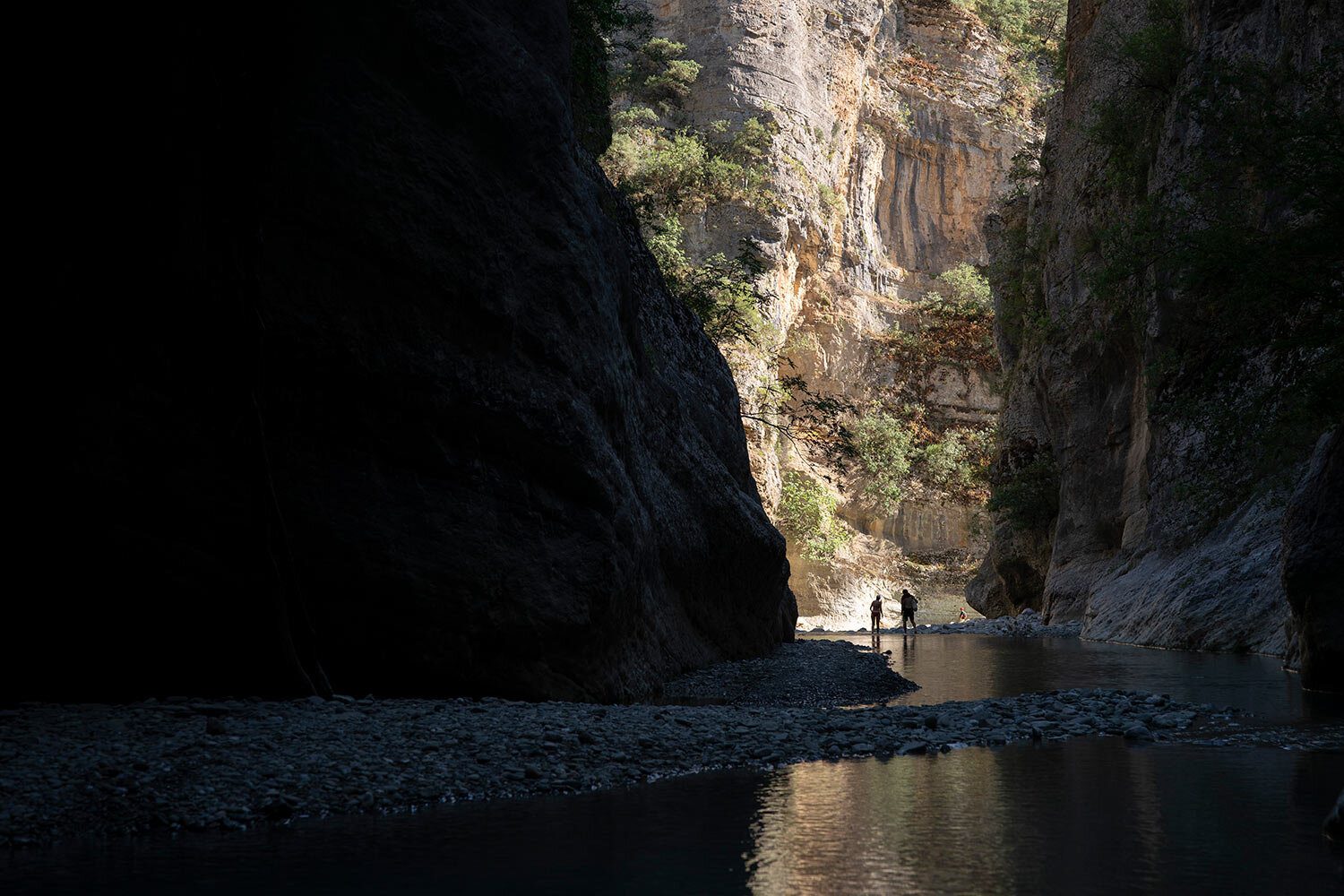 People walk along the Langarica River, a tributary to the Vjosa near Permet, Albania. (AP Photo/Felipe Dana)