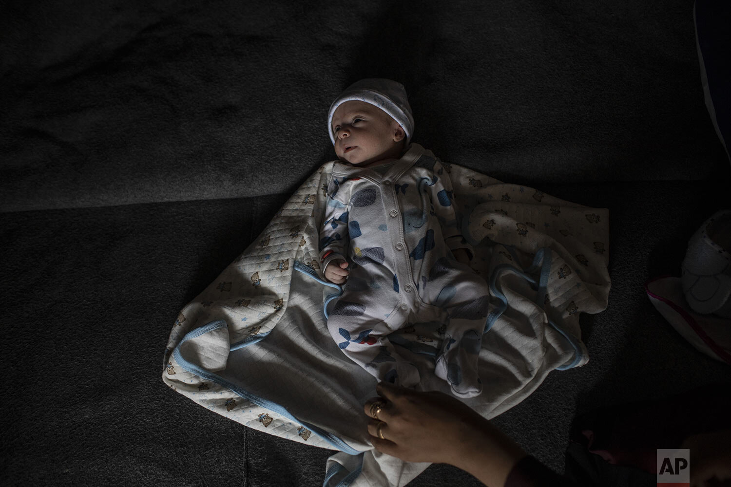 Six day-old Mohamed Helale, from Syria, who was born in Greece lays inside a tent at the Moria refugee and migrant camp on the Greek island of Lesbos, Saturday Oct. 5, 2019. ( AP Photo/Petros Giannakouris)