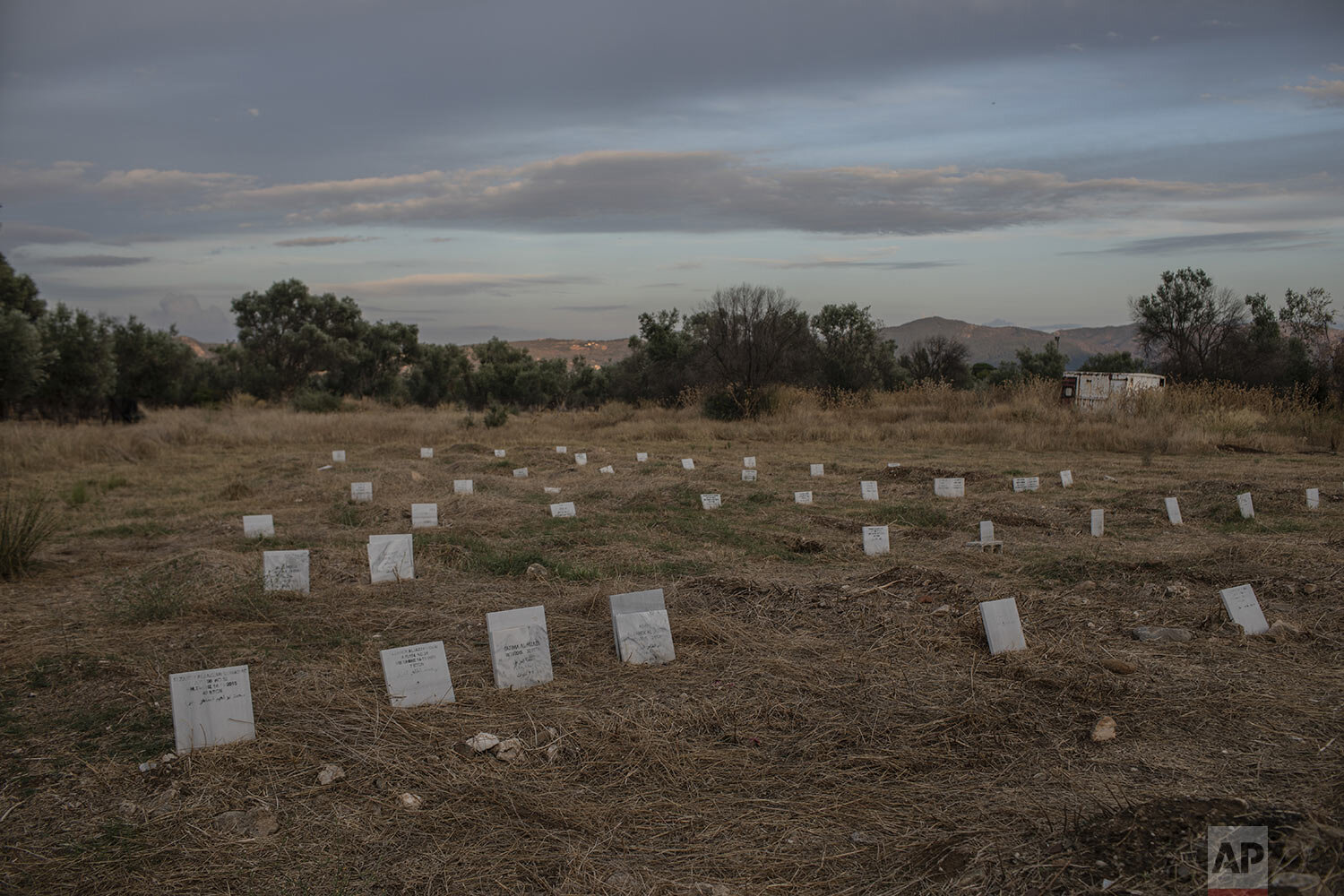 Tombstones marking the graves of migrants and refugees who drowned at sea while crossing from nearby Turkey are seen at a cemetery near the village of Kato Tritos on the northeastern Aegean island of Lesbos, Greece, Saturday Oct. 5, 2019. (AP Photo/Petros Giannakouris)