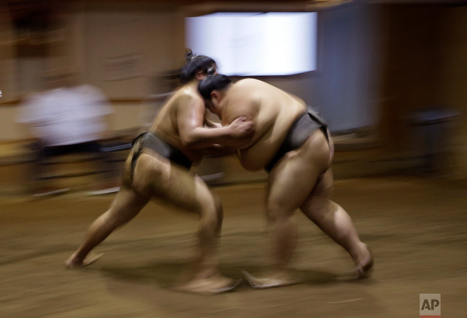 Sumo wrestlers train at the Musashigawa Sumo Stable at Beppu, western Japan on Friday, Oct. 18, 2019. Sumo wrestling is a traditional Japanese sport. (AP Photo/Aaron Favila)