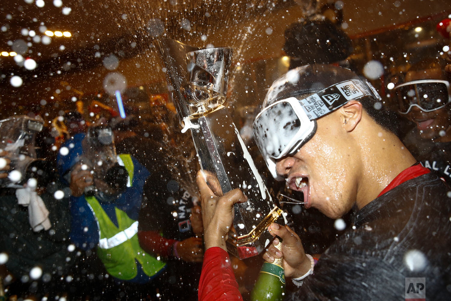 Washington Nationals' Juan Soto celebrates after Game 4 of the baseball National League Championship Series against the St. Louis Cardinals Wednesday, Oct. 16, 2019, in Washington. The Nationals won 7-4 to win the series 4-0. (AP Photo/Patrick Semansky)