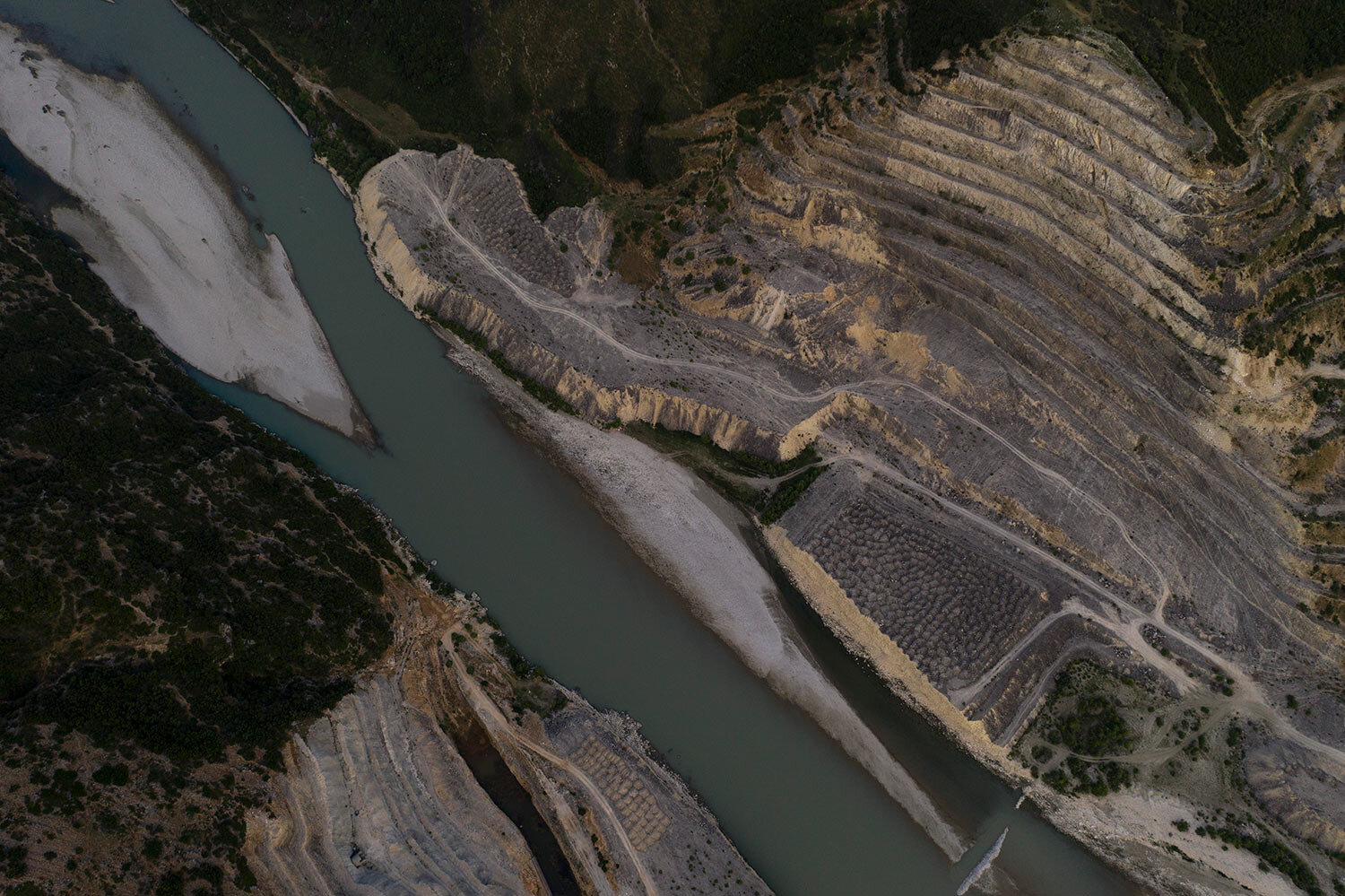 This aerial photo shows the construction site of the Kalivac dam on the banks of the Vjosa River in Albania. (AP Photo/Felipe Dana)