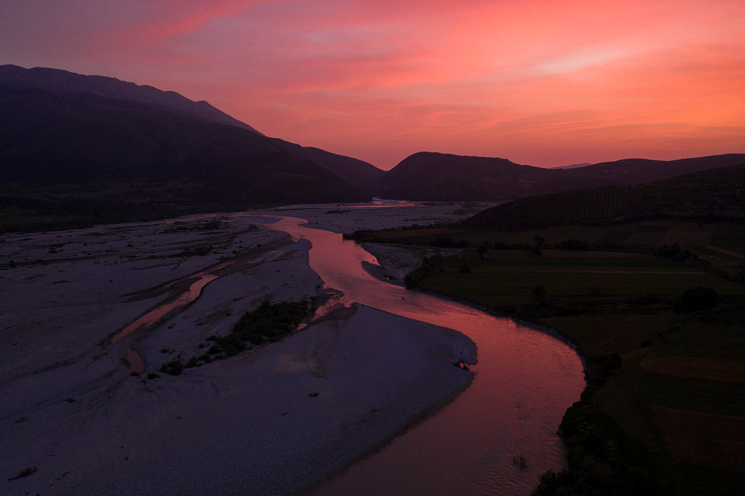 The sun sets behind the Vjosa River near Tepelene, Albania. Rivers are a crucial part of the global water cycle. (AP Photo/Felipe Dana)