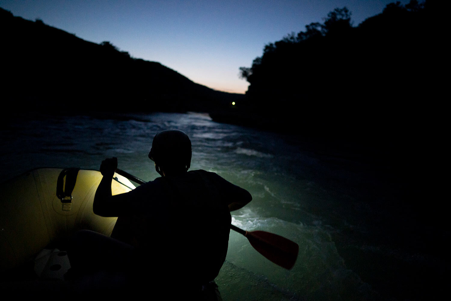 A river rafting guide paddles at dusk on the Vjosa River, Albania. (AP Photo/Felipe Dana)