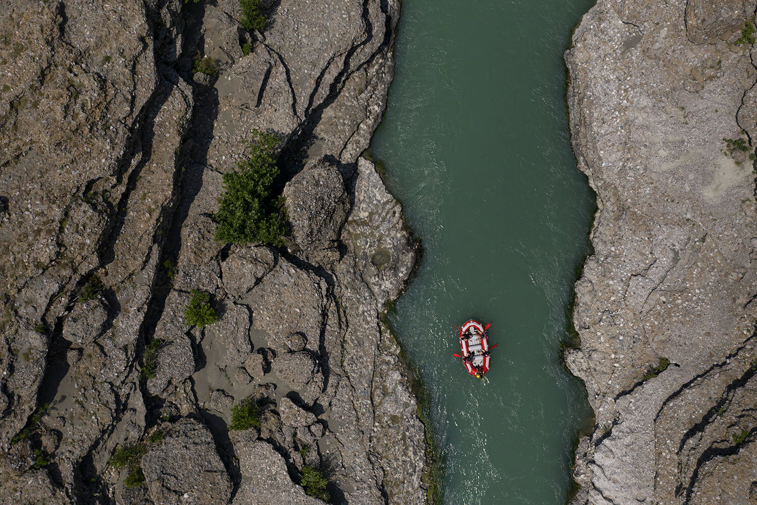 People raft on the Vjosa River near Permet, Albania. (AP Photo/Felipe Dana)