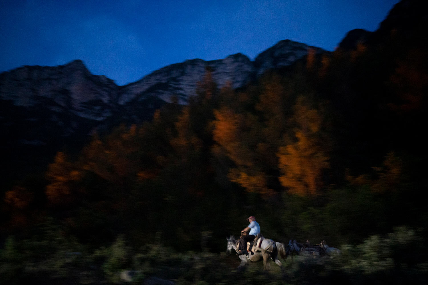 Jonuz Jonuzi, 70, rides his horse on the banks of the Vjosa River in the Kelcyre Gorge, Albania.(AP Photo/Felipe Dana)