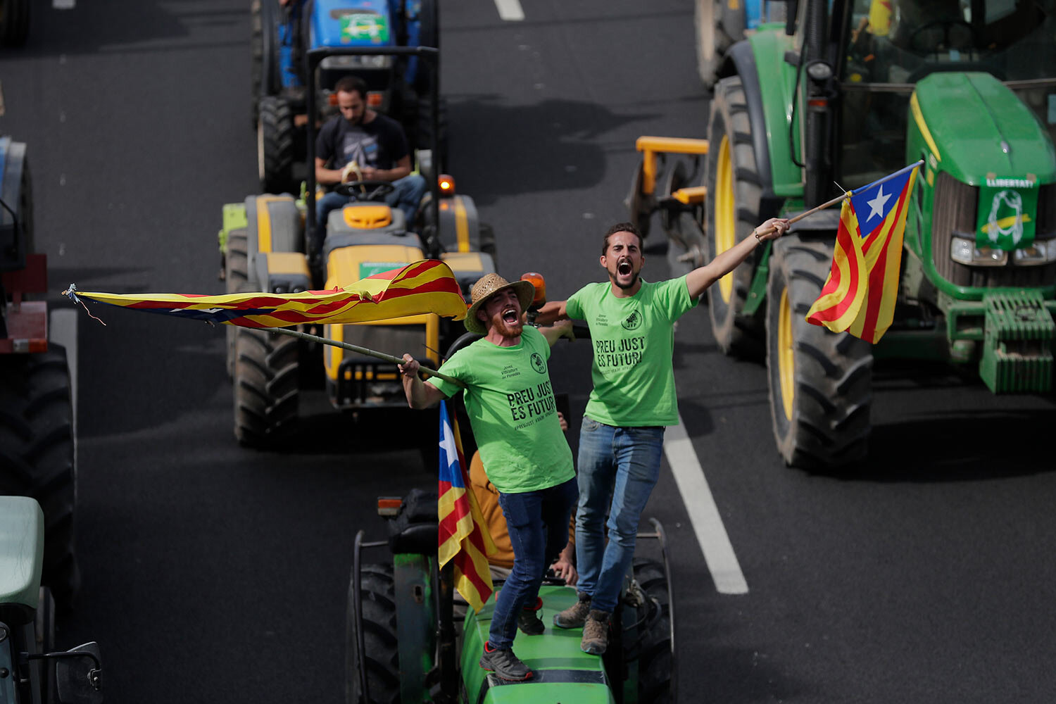 Protesters ride on tractors as they enter the city on the fifth day of protests over the conviction of a dozen Catalan independence leaders in Barcelona, Spain, Friday, Oct. 18, 2019.(AP Photo/Manu Fernandez)