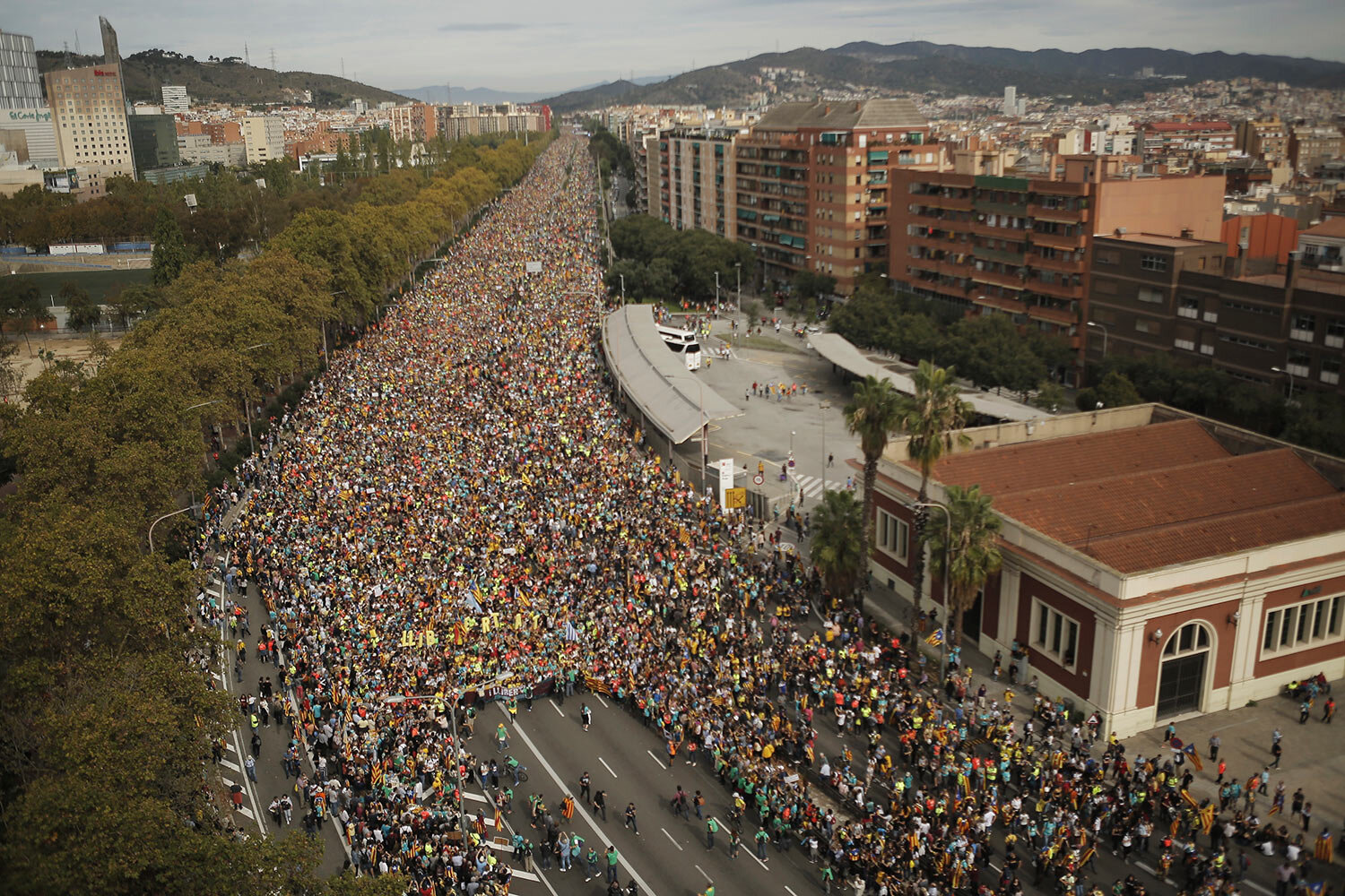 Protesters march into the city on the fifth day of protests over the conviction of a dozen Catalan independence leaders in Barcelona, Spain, Friday, Oct. 18, 2019. (AP Photo/Joan Mateu)