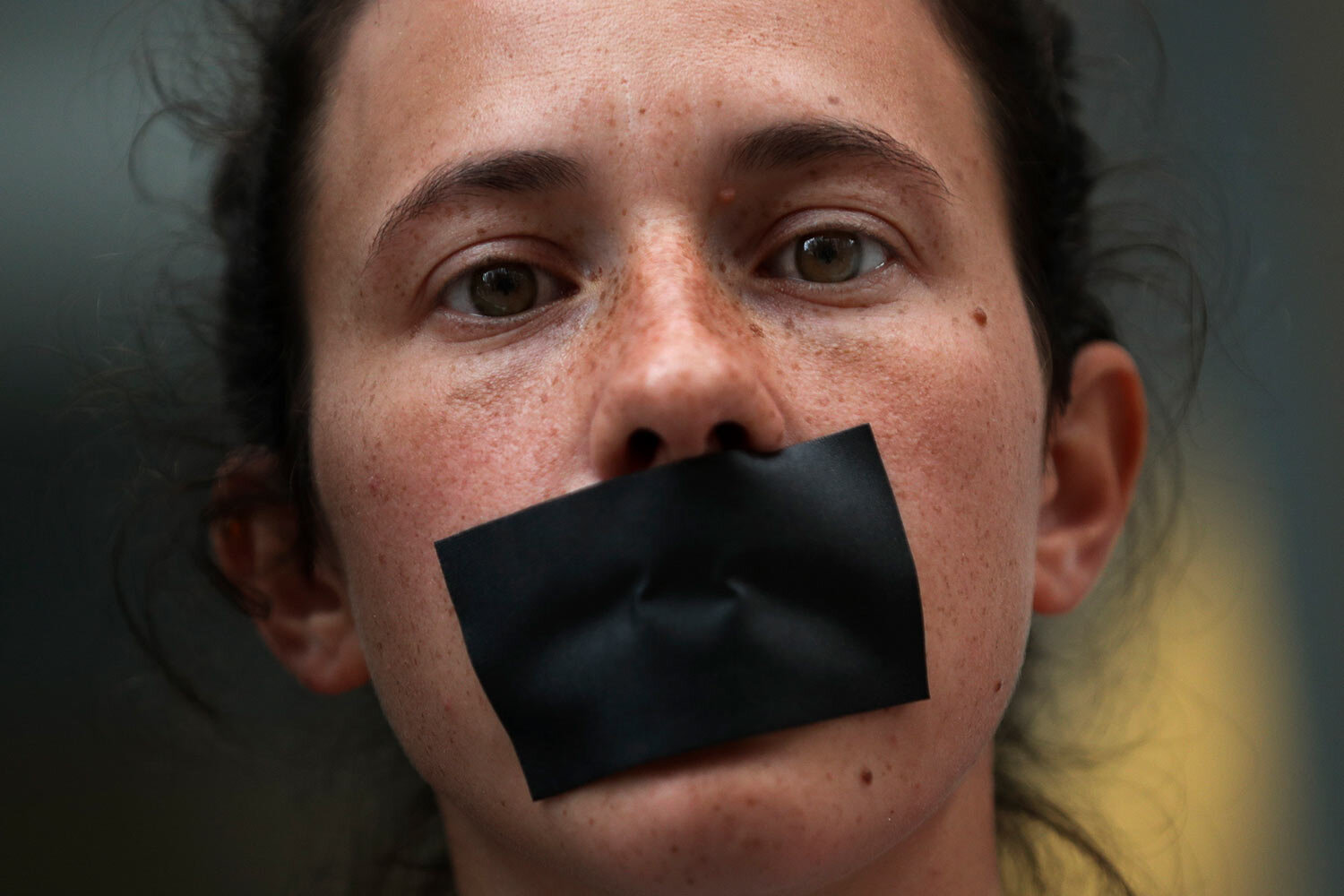 A pro-Catalonia independence protestor covers her mouth with tape as she protests in Brussels, Monday, Oct. 14, 2019. (AP Photo/Francisco Seco)